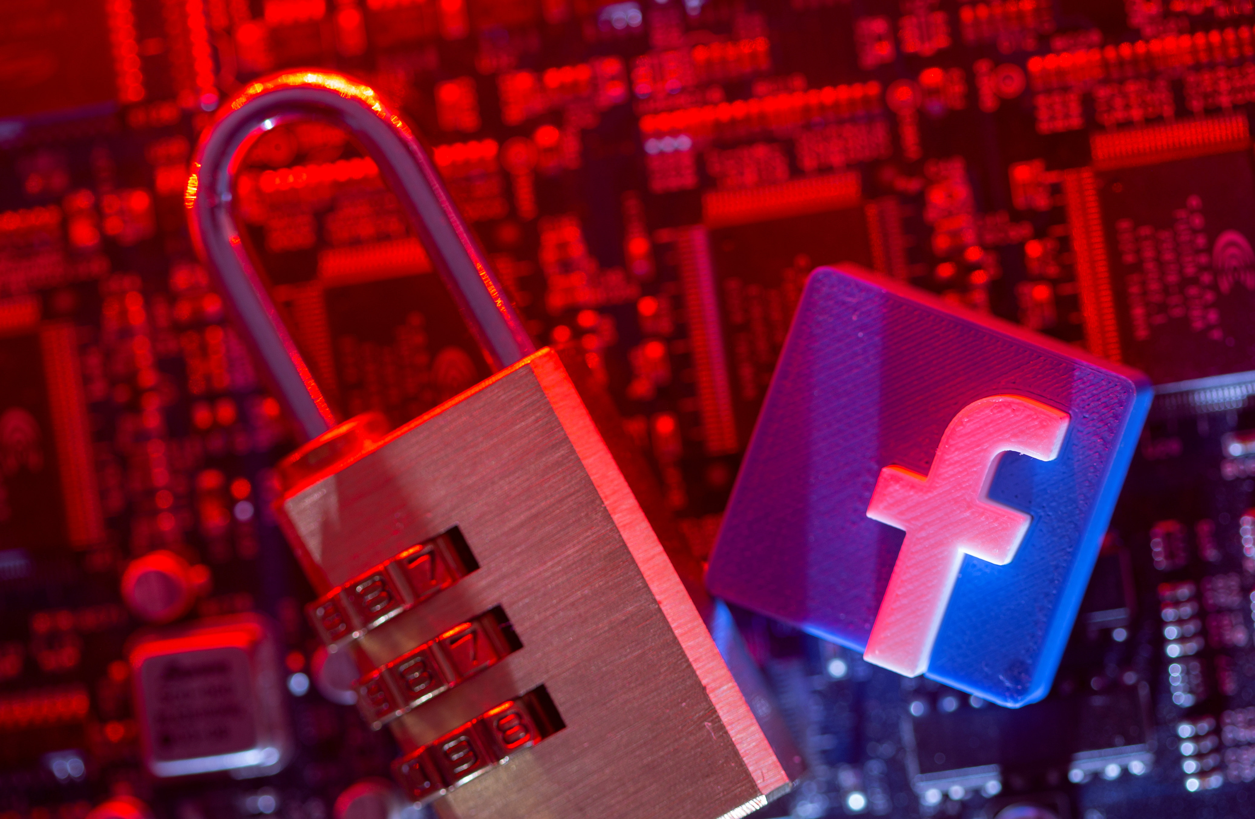 A 3D printed Facebook logo and a padlock are placed on a computer motherboard in this illustration picture taken May 4, 2021. REUTERS/Dado Ruvic/Illustration