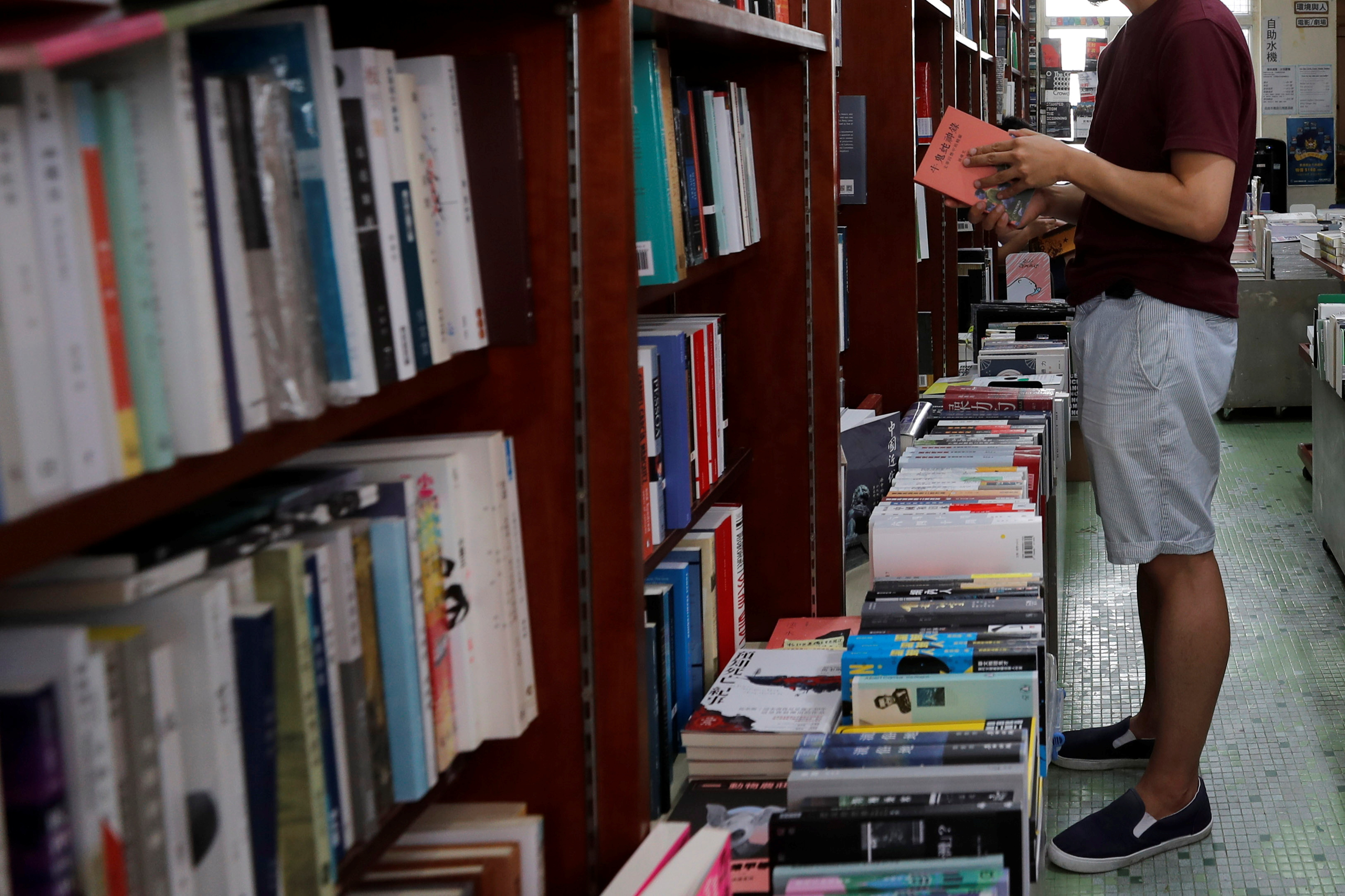 A man reads a book at independent bookstore