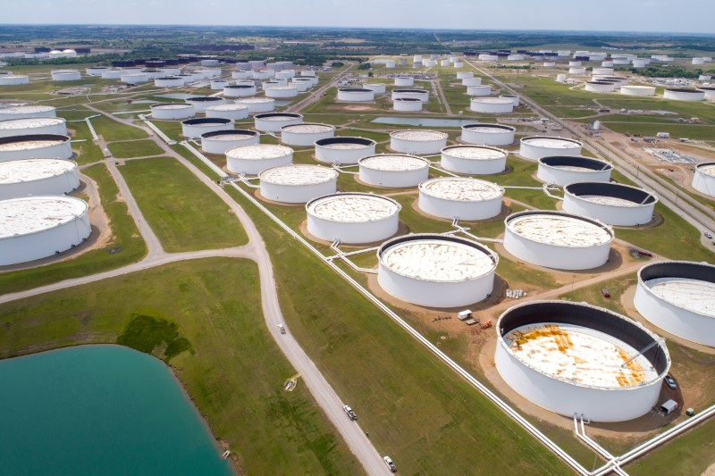 Crude oil storage tanks are seen in an aerial photograph at the Cushing oil hub in Cushing, Oklahoma, U.S. April 21, 2020. REUTERS/Drone Base/File Photo