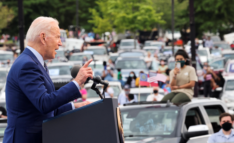 U.S. President Joe Biden gestures as he speaks during the Democratic National Committee's