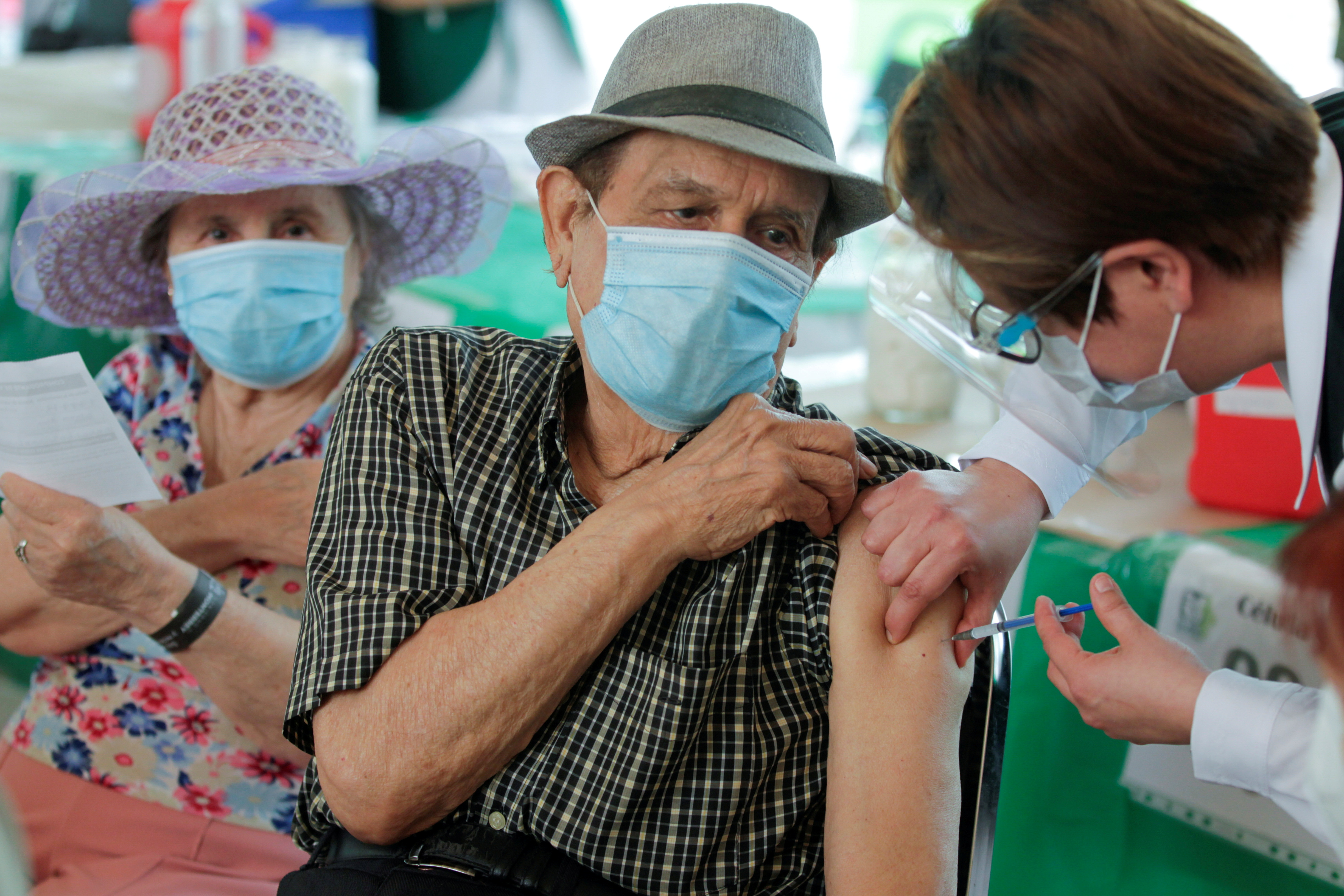 A man receives a dose of the AstraZeneca coronavirus disease (COVID-19) vaccine, during a mass vaccination program in Monterrey, Mexico April 12, 2021. REUTERS/Daniel Becerril/File Photo