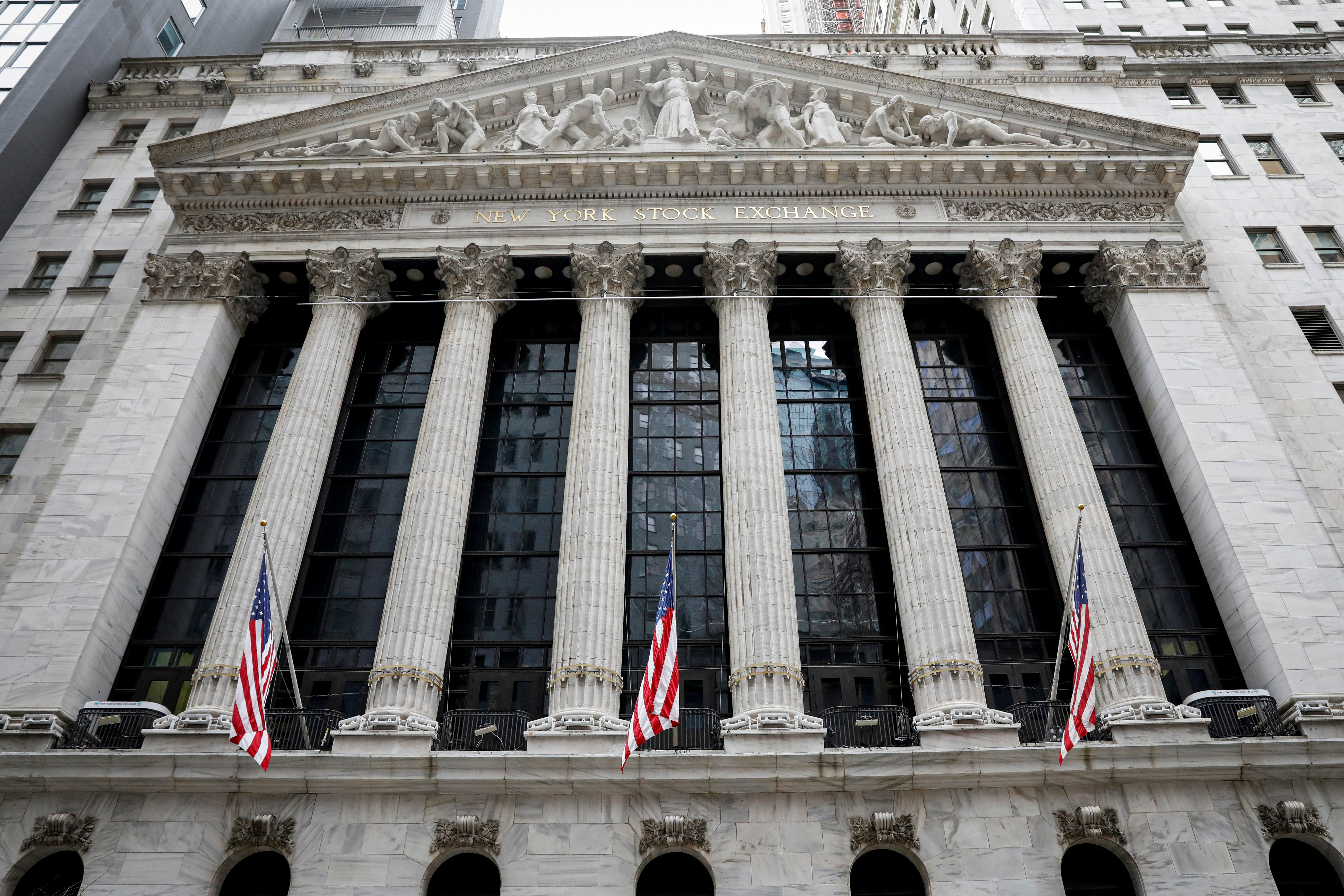 The front facade of the New York Stock Exchange (NYSE) is seen in New York, U.S., February 12, 2021. REUTERS/Brendan McDermid/File Photo