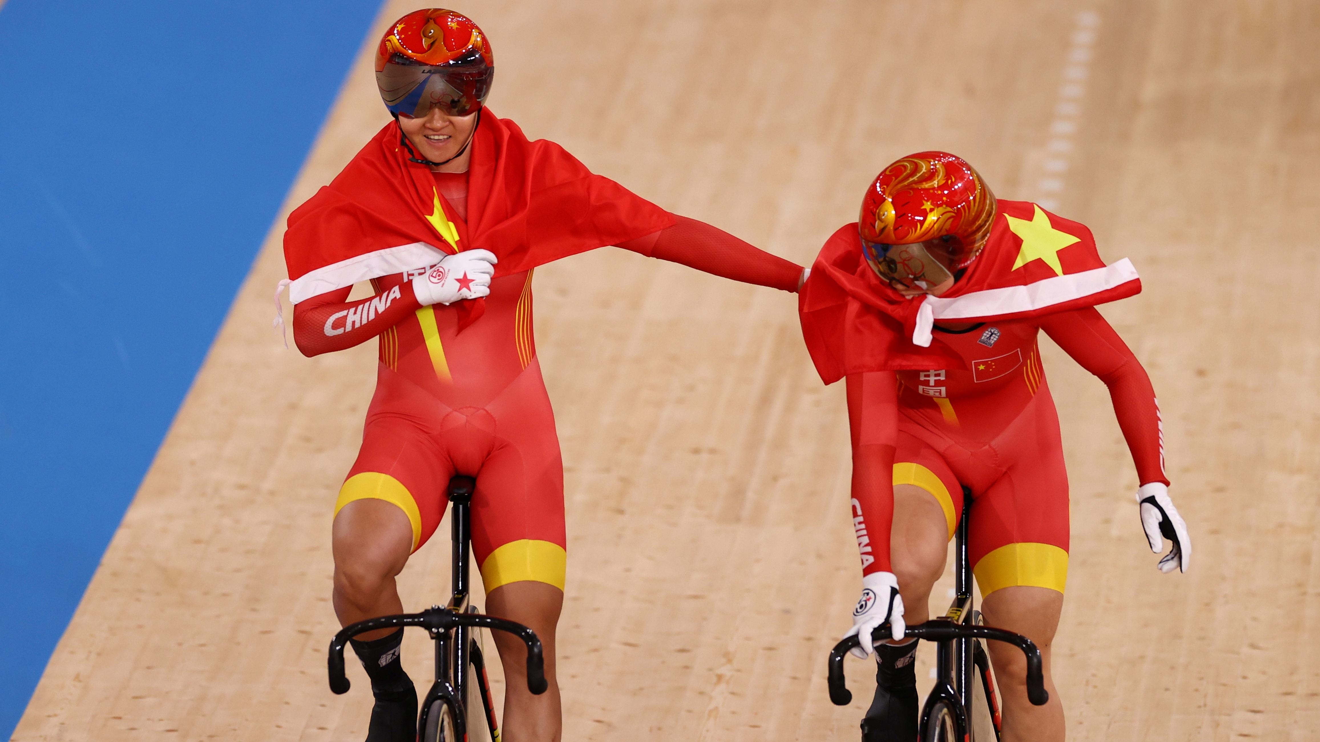 Tokyo 2020 Olympics - Cycling - Track - Women's Team Sprint - Gold Final - Izu Velodrome, Shizuoka, Japan - August 2, 2021. Bao Shanju of China and Zhong Tianshi of China celebrate winning the race and the gold medal. REUTERS/Kacper Pempel