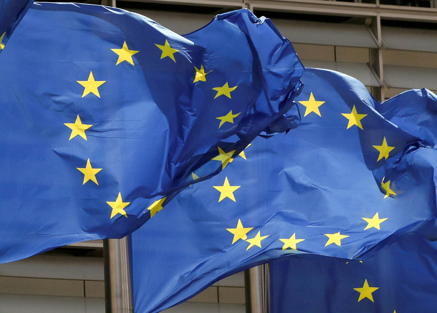 European Union flags flutter outside the EU Commission headquarters in Brussels, Belgium May 5, 2021. REUTERS/Yves Herman