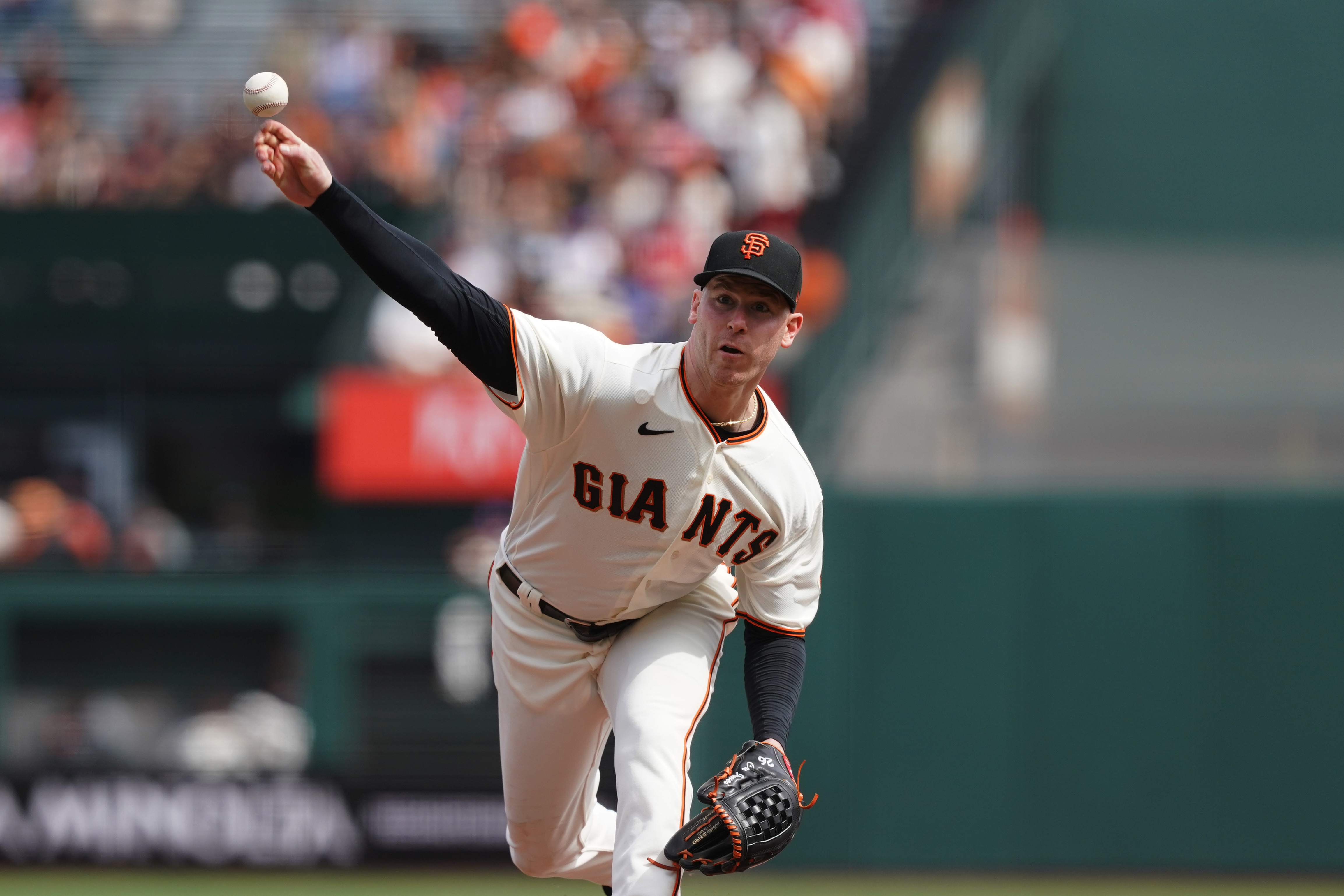 Sep 19, 2021; San Francisco, California, USA; San Francisco Giants starting pitcher Anthony DeSclafani (26) throws a pitch during the third inning against the Atlanta Braves at Oracle Park. Mandatory Credit: Darren Yamashita-USA TODAY Sports