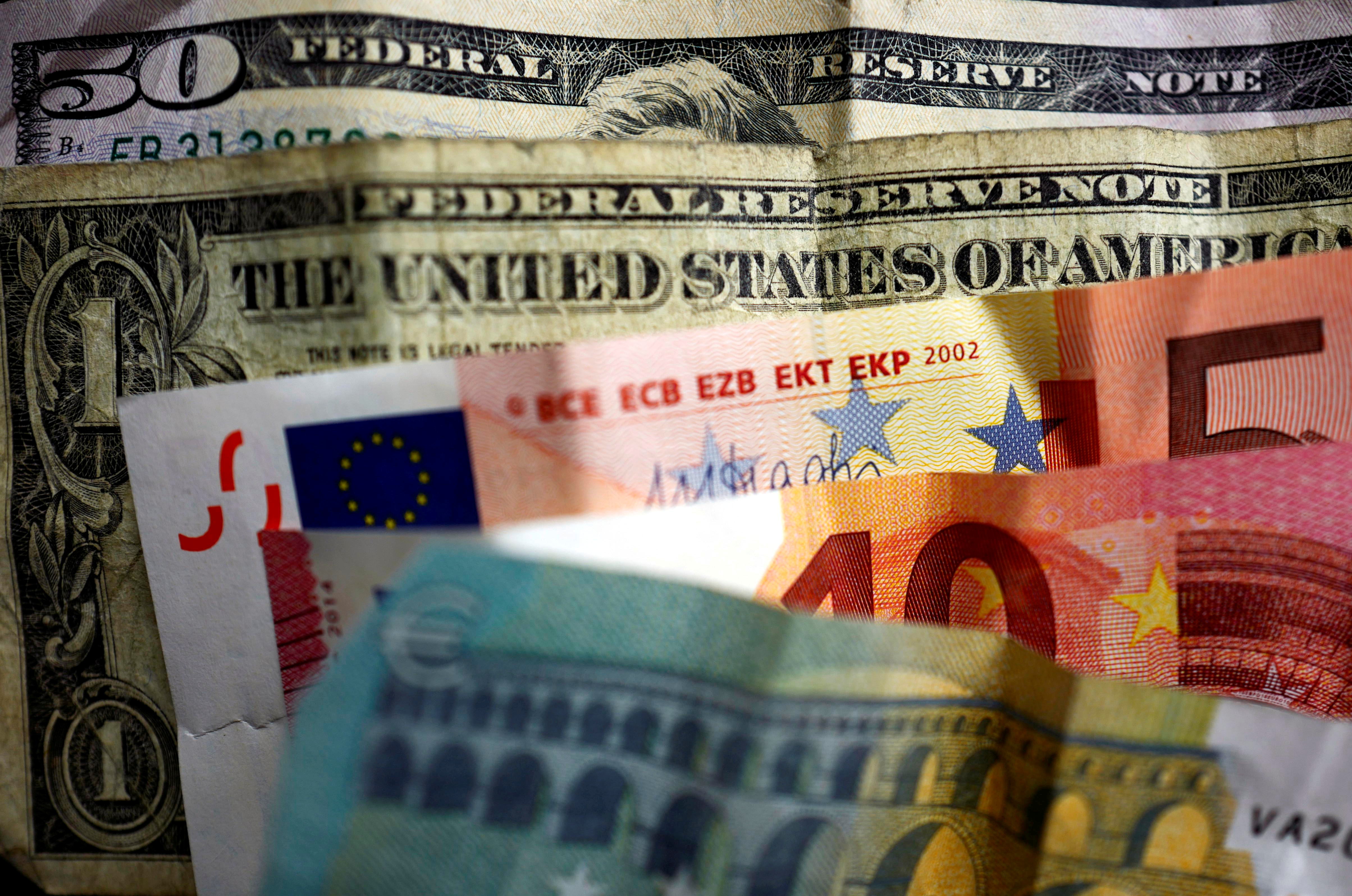 U.S. dollar and Euro bank notes are photographed in Frankfurt, Germany, in this illustration picture taken May 7, 2017. May 7, 2017. REUTERS/Kai Pfaffenbach/Illustration/File Photo