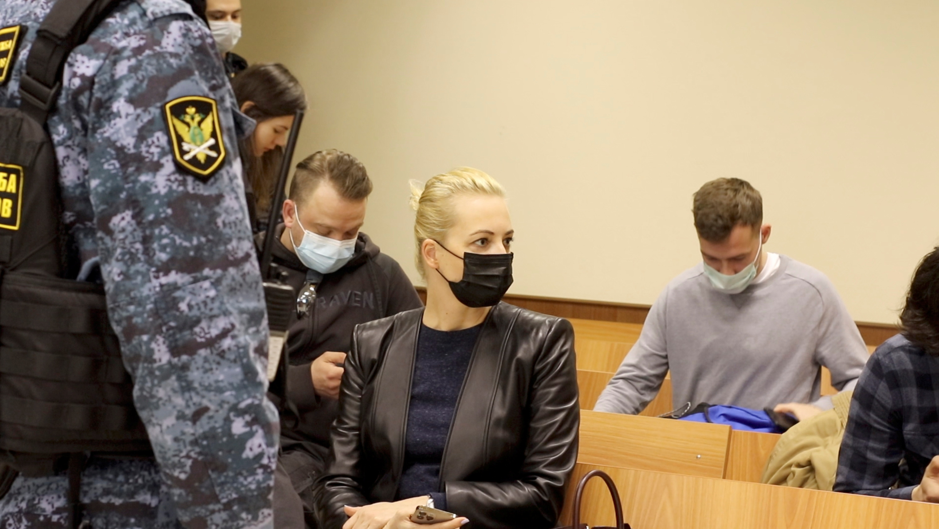 Yulia Navalnaya, wife of Russian opposition leader Alexei Navalny, is seen in a courtroom before a hearing to consider an appeal against an earlier court decision that found Navalny guilty of slandering a Russian World War Two veteran, in Moscow, Russia April 29, 2021, in this still image taken from video. Press Service of Babushkinsky District Court of Moscow/Handout via REUTERS