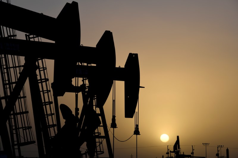 Pump jacks operate at sunset in Midland, Texas, U.S., February 11, 2019. Picture taken February 11, 2019.   REUTERS/Nick Oxford/File Photo