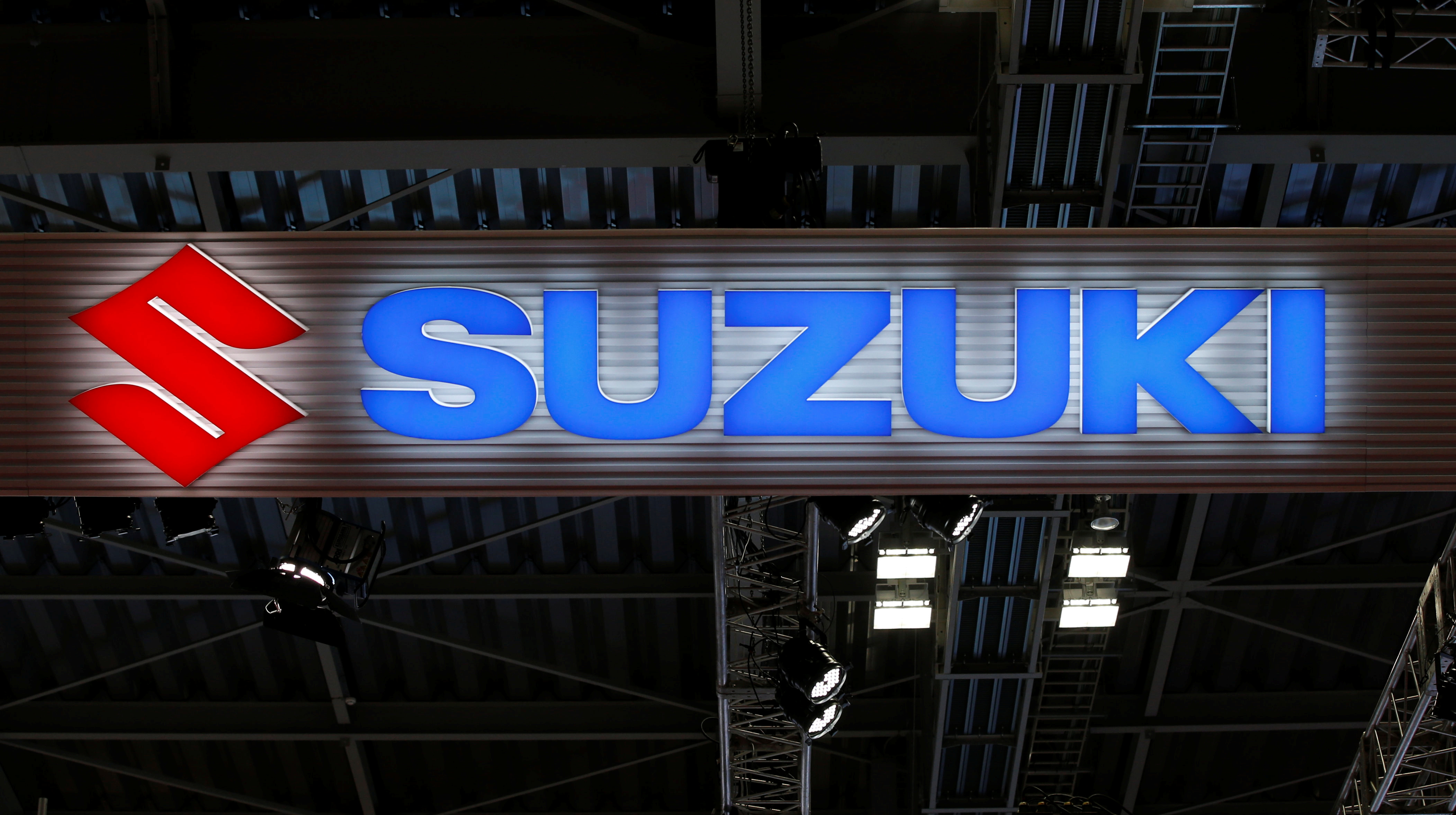 The logo of Suzuki Motor Corp. is pictured at the 45th Tokyo Motor Show in Tokyo, Japan October 25, 2017. Picture taken October 25, 2017.  REUTERS/Toru Hanai/Files