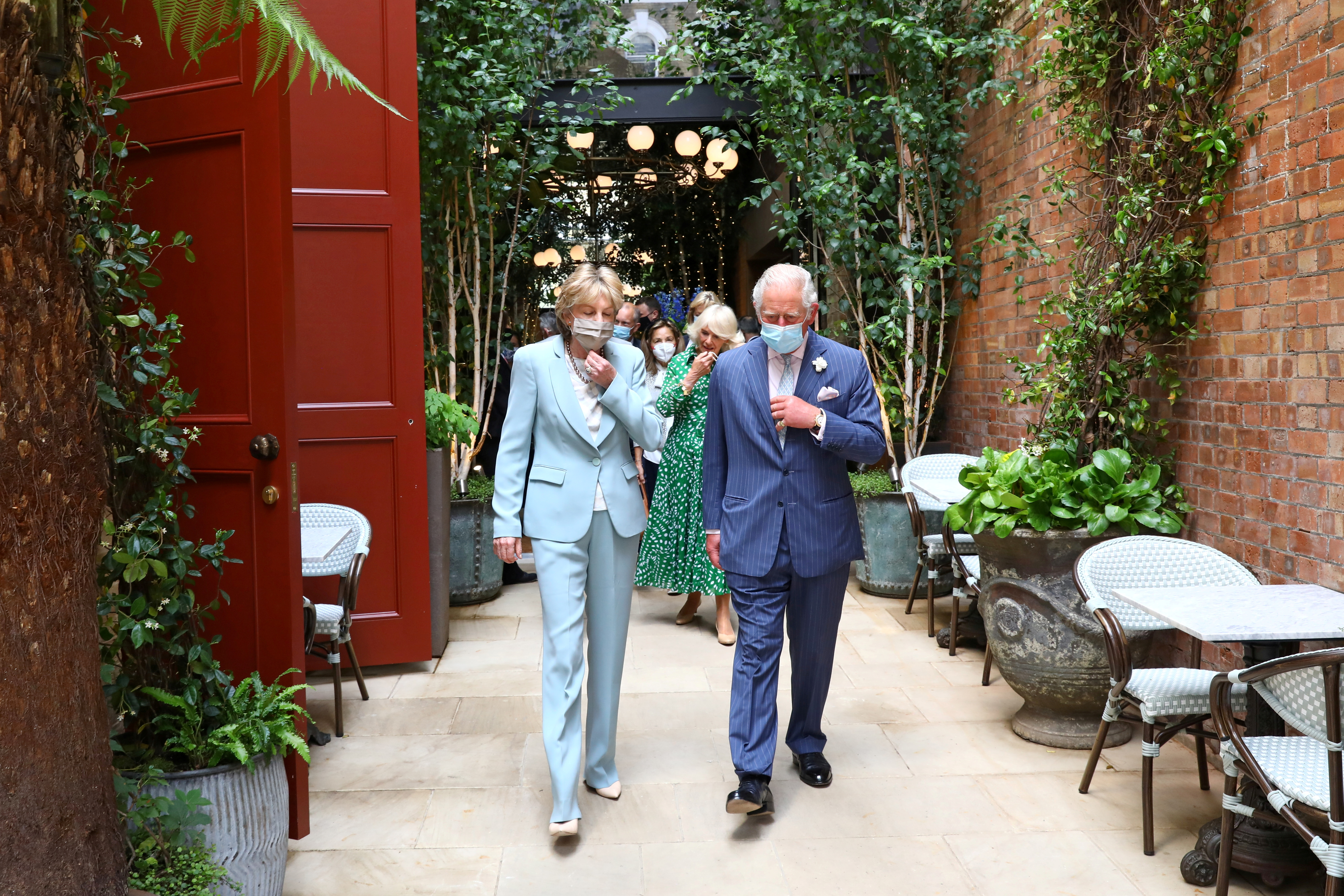 Britain's Prince Charles and Camilla, Duchess of Cornwall, walk with Lady Madeleine Lloyd Webber during a visit to Theatre Royal in London, Britain June 23, 2021. Tim P. Whitby/Pool via REUTERS