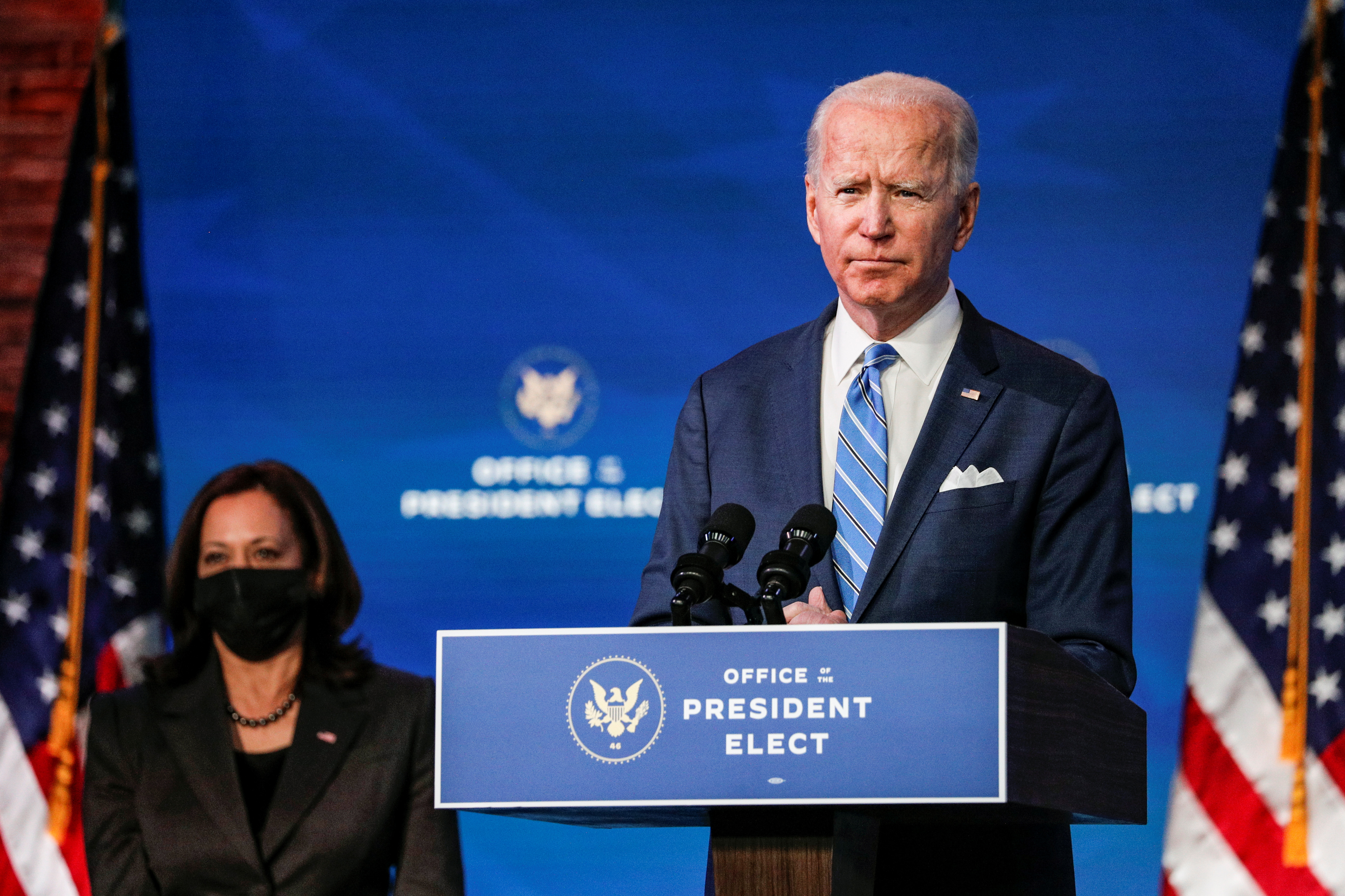 U.S. President-elect Joe Biden delivers remarks as Vice President-elect Kamala Harris looks on during a televised speech on the current economic and health crises at The Queen Theatre in Wilmington, Delaware, U.S., January 14, 2021. REUTERS/Tom Brenner