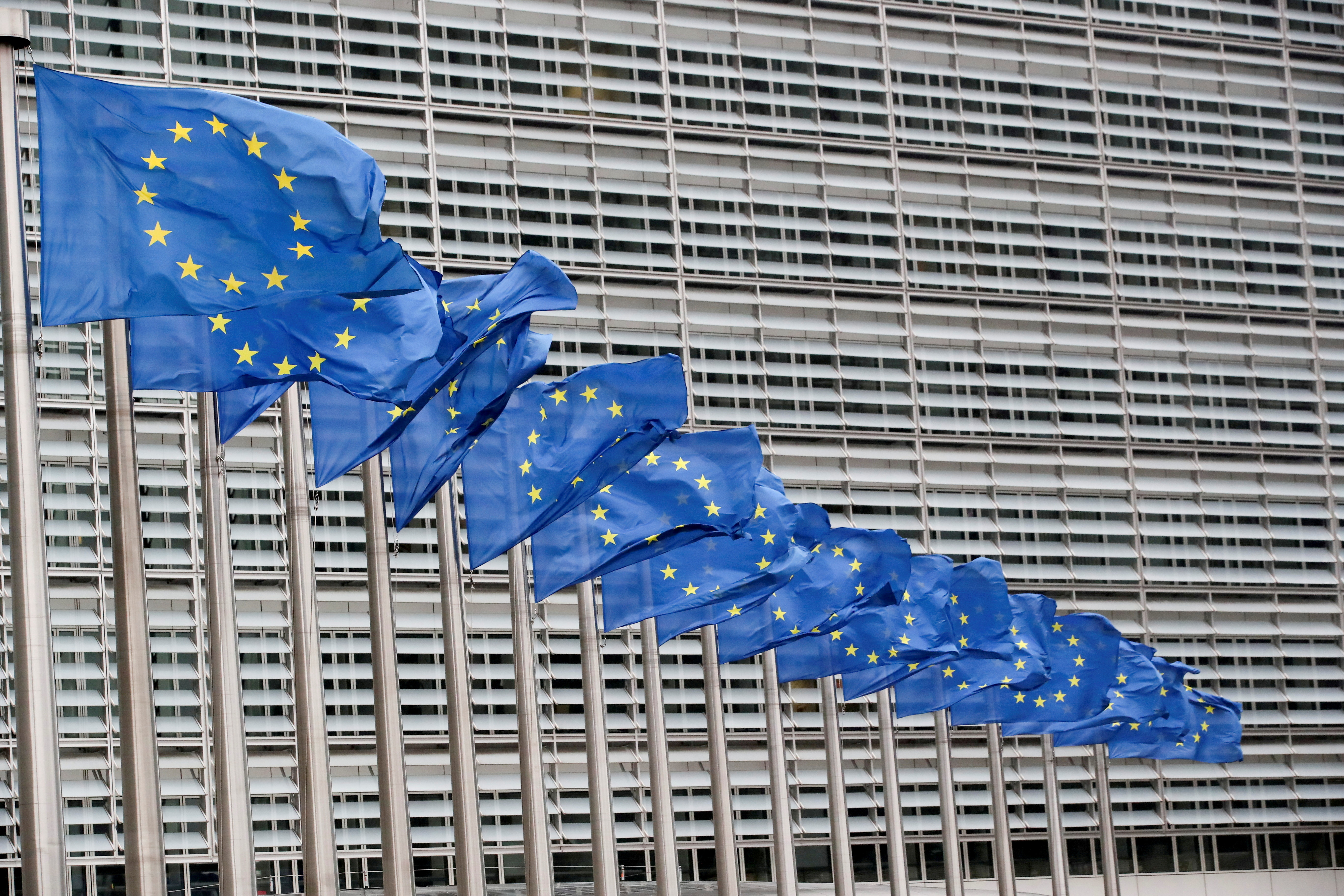 European Union flags flutter outside the EU Commission headquarters in Brussels, Belgium, July 14, 2021. REUTERS/Yves Herman/File Photo