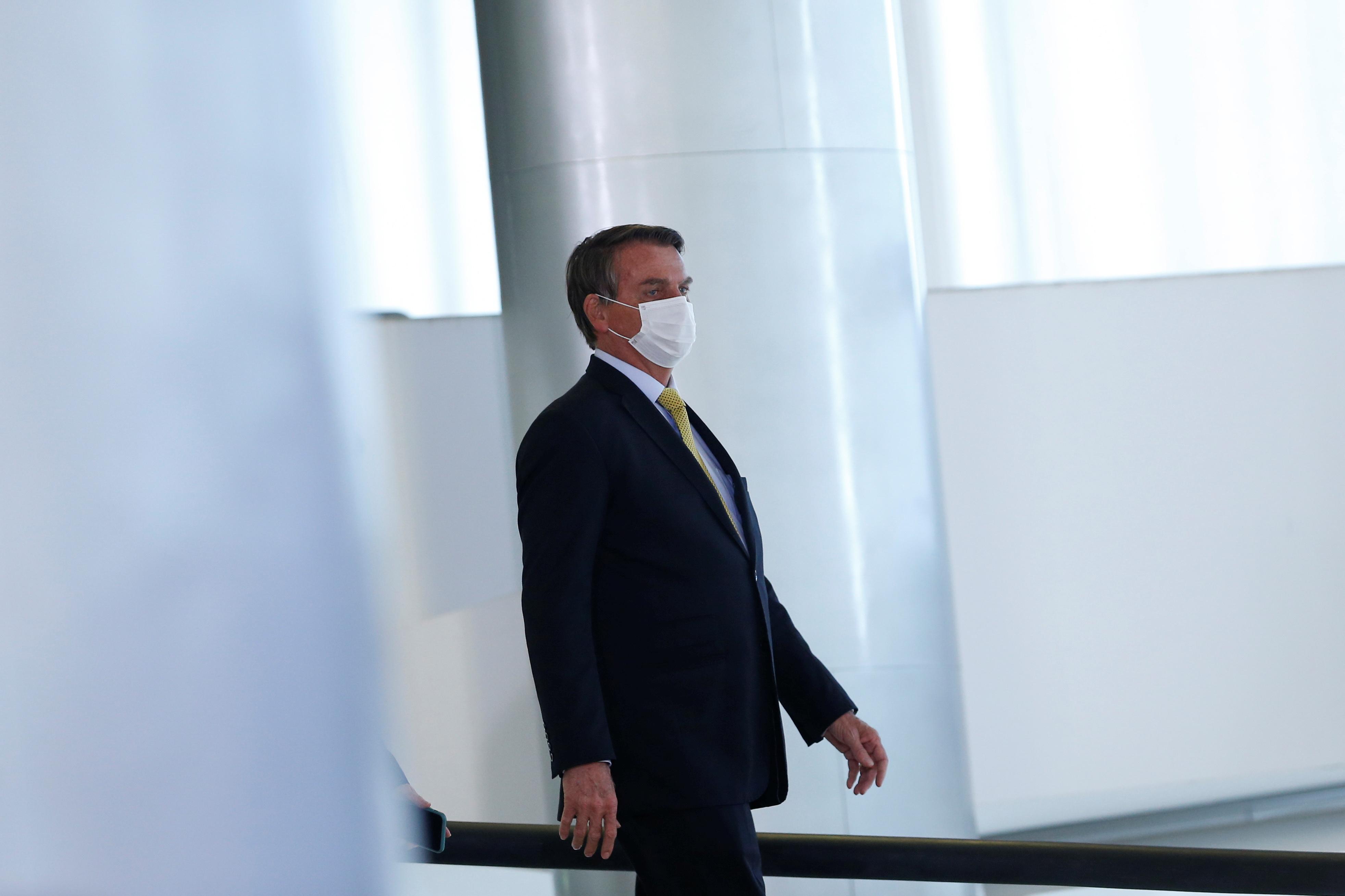 Brazil's President Jair Bolsonaro walks before a ceremony at the Planalto Palace in Brasilia, Brazil, June 29, 2021. REUTERS/Adriano Machado