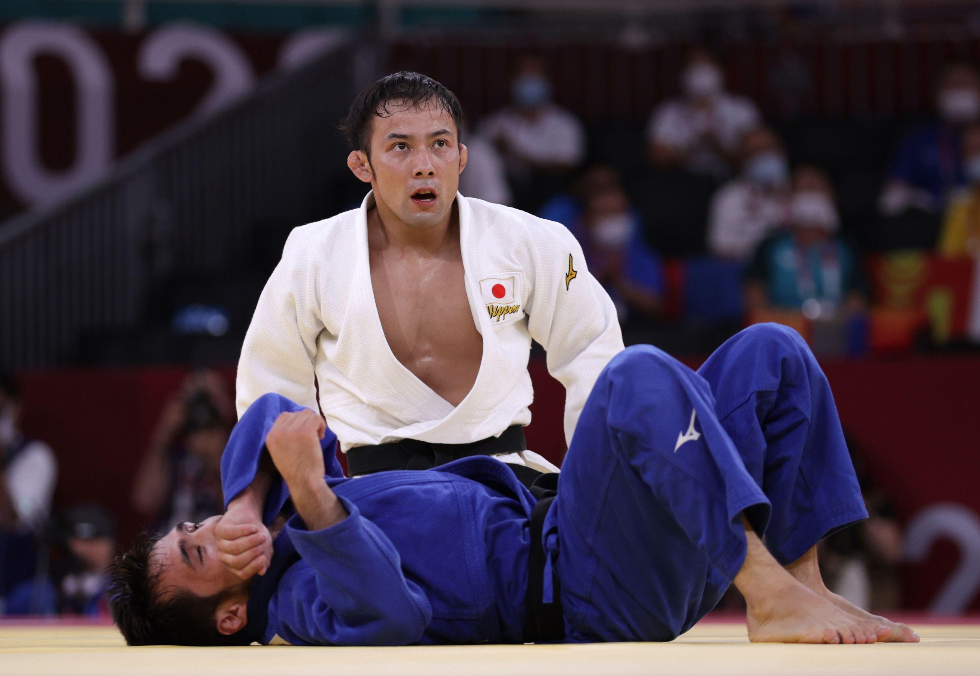 Tokyo 2020 Olympics - Judo - Men's 60kg - Semifinal - Nippon Budokan - Tokyo, Japan - July 24, 2021. Naohisa Takato of Japan reacts after performing the winning move against Yeldos Smetov of Kazakhstan REUTERS/Hannah Mckay