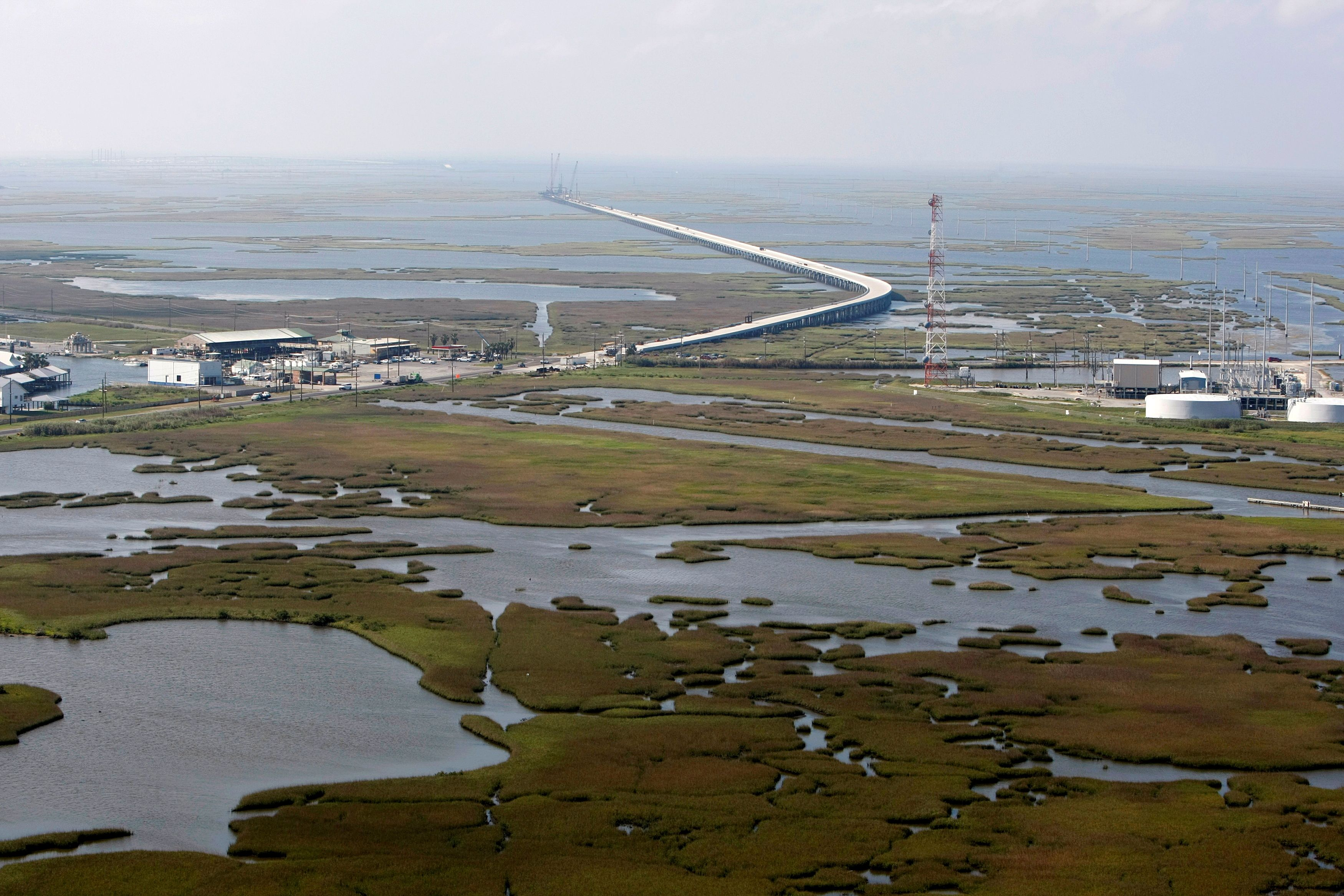 An aerial view is seen of the town of Port Fourchon and its surrounding marshes in Louisiana, May 11, 2010. REUTERS/Rick Wilking//File Photo
