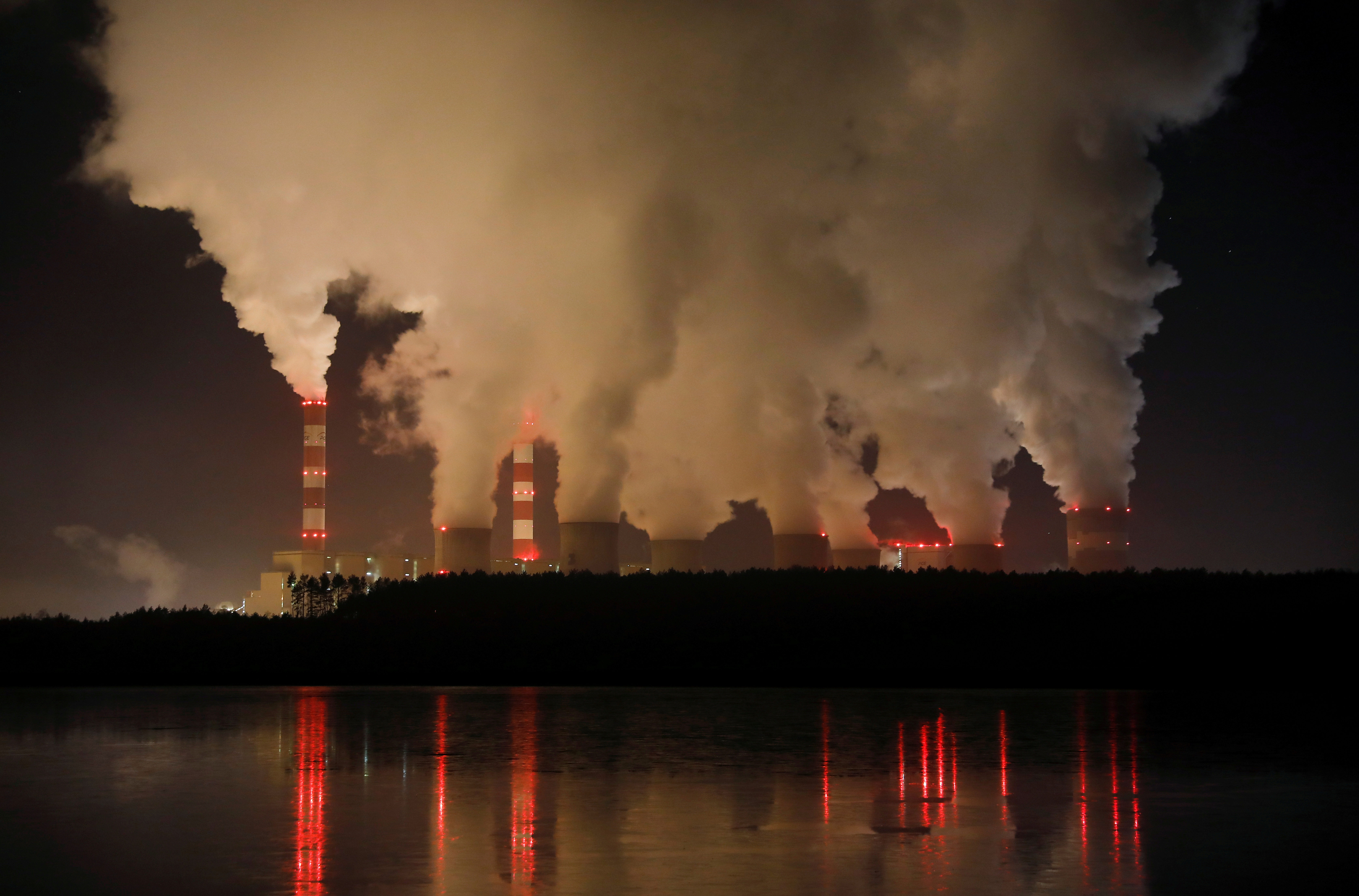 Smoke and steam billows from Belchatow Power Station, Europe's largest coal-fired power plant operated by PGE Group, at night near Belchatow, Poland December 5, 2018. REUTERS/Kacper Pempel/File Photo