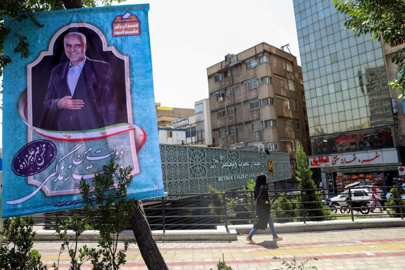 A banner of presidential candidate Mohsen Mehralizadeh is seen in a street in Tehran, Iran June 15, 2021. Majid Asgaripour/WANA (West Asia News Agency) via REUTERS