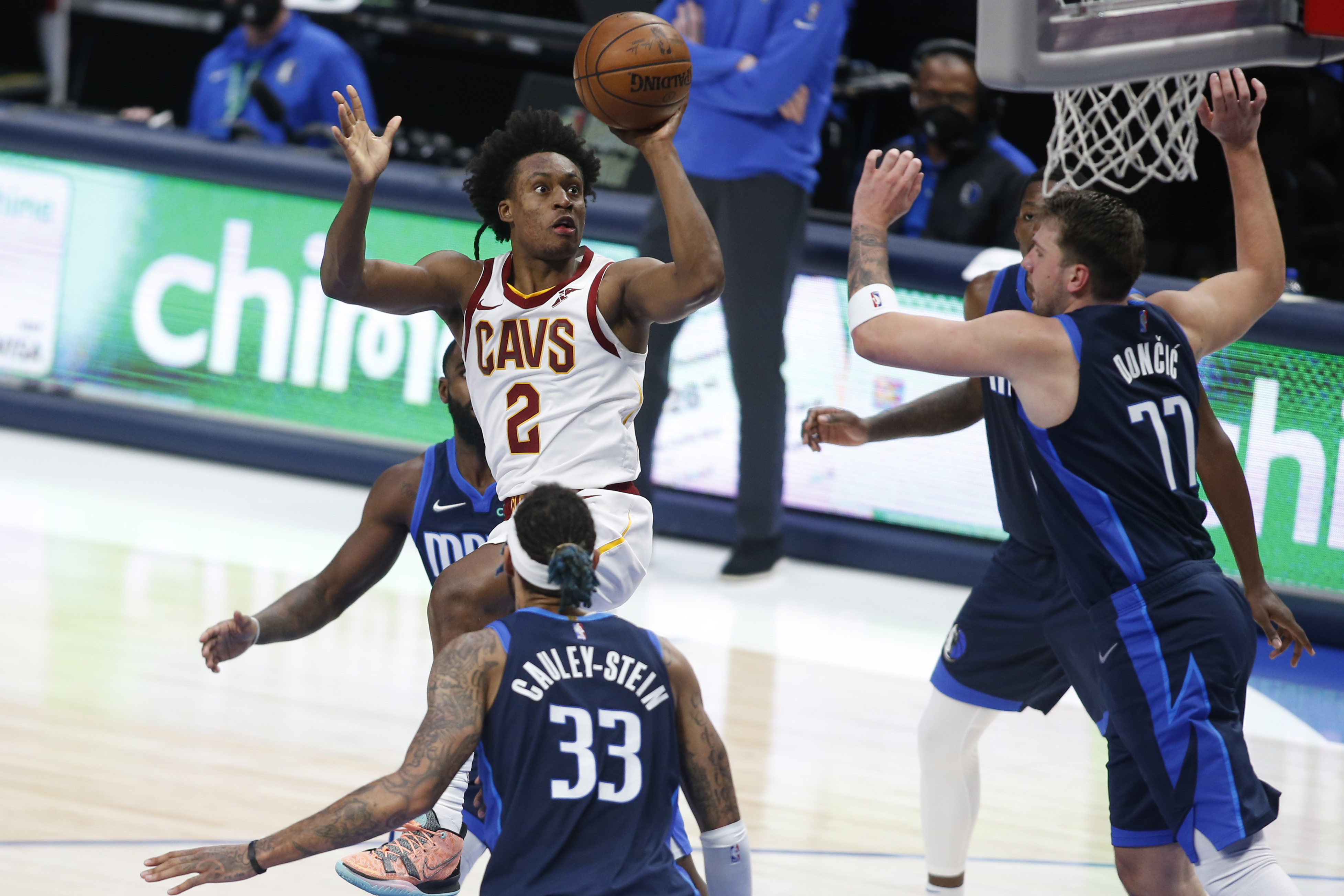 May 7, 2021; Dallas, Texas, USA; Cleveland Cavaliers guard Collin Sexton (2) drives against Dallas Mavericks guard Luka Doncic (77) during the third quarter at American Airlines Center. Mandatory Credit: Tim Heitman-USA TODAY Sports