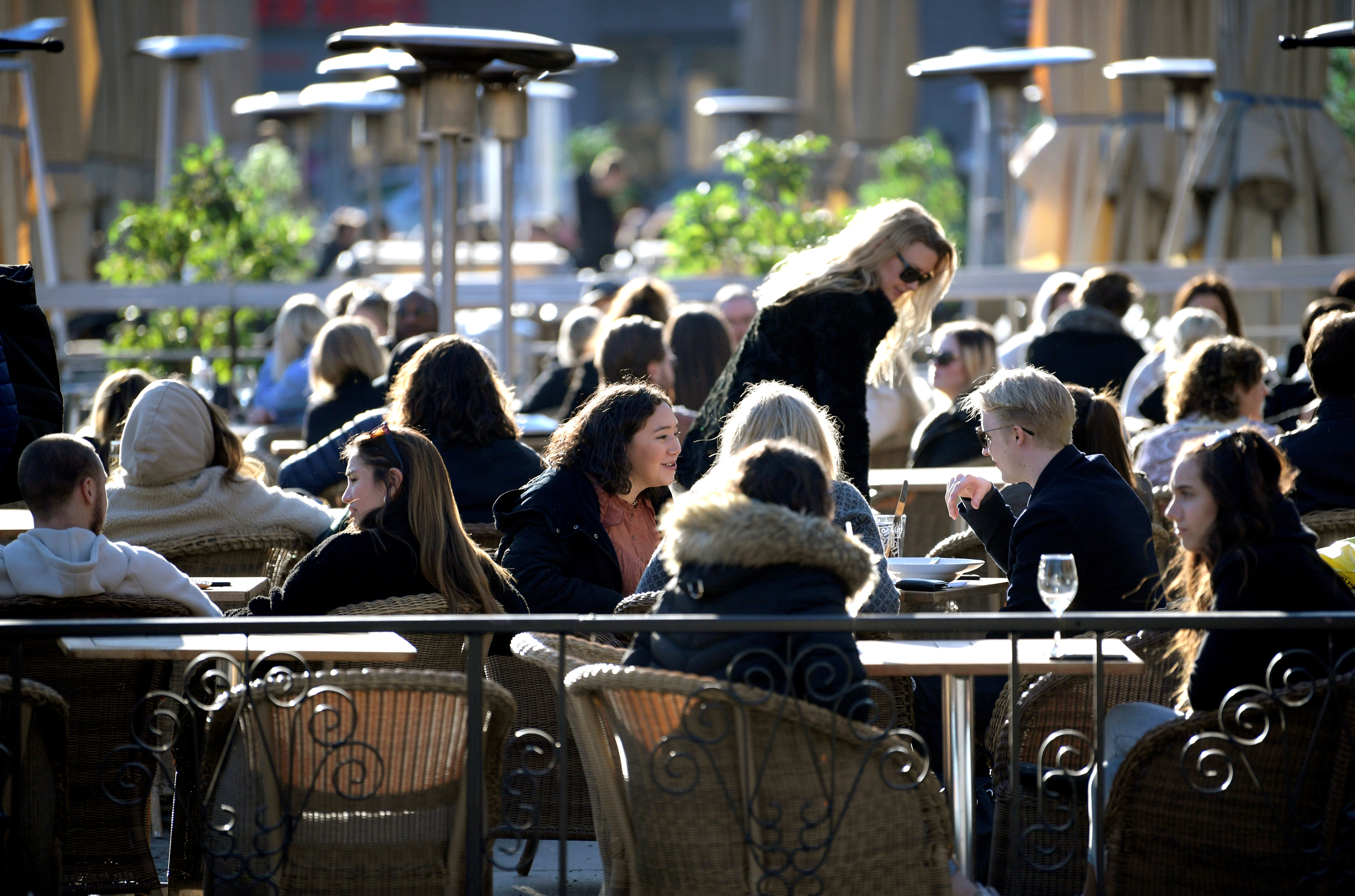 People enjoy the sun at an outdoor restaurant, despite the continuing spread of coronavirus disease (COVID-19), in Stockholm, Sweden March 26, 2020. TT News Agency/Janerik Henriksson via REUTERS /File Photo