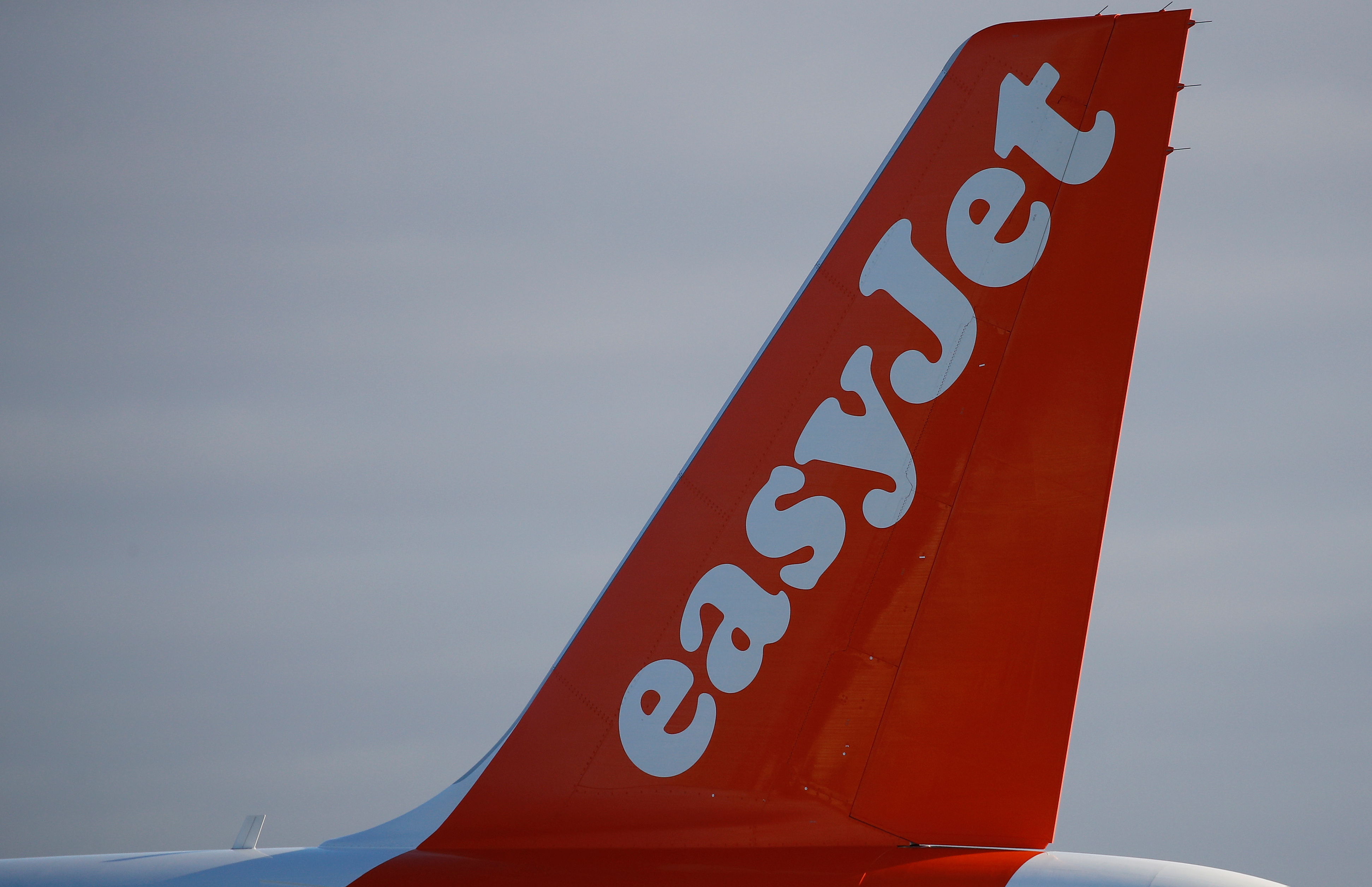 The company logo is seen on the tail of an Easyjet plane at Manchester Airport in Manchester, Britain January 20, 2020. REUTERS/Phil Noble