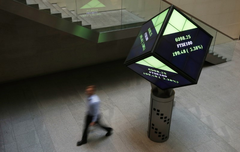 A man walks through the lobby of the London Stock Exchange in London, Britain August 25, 2015. REUTERS/Suzanne Plunkett/File photo