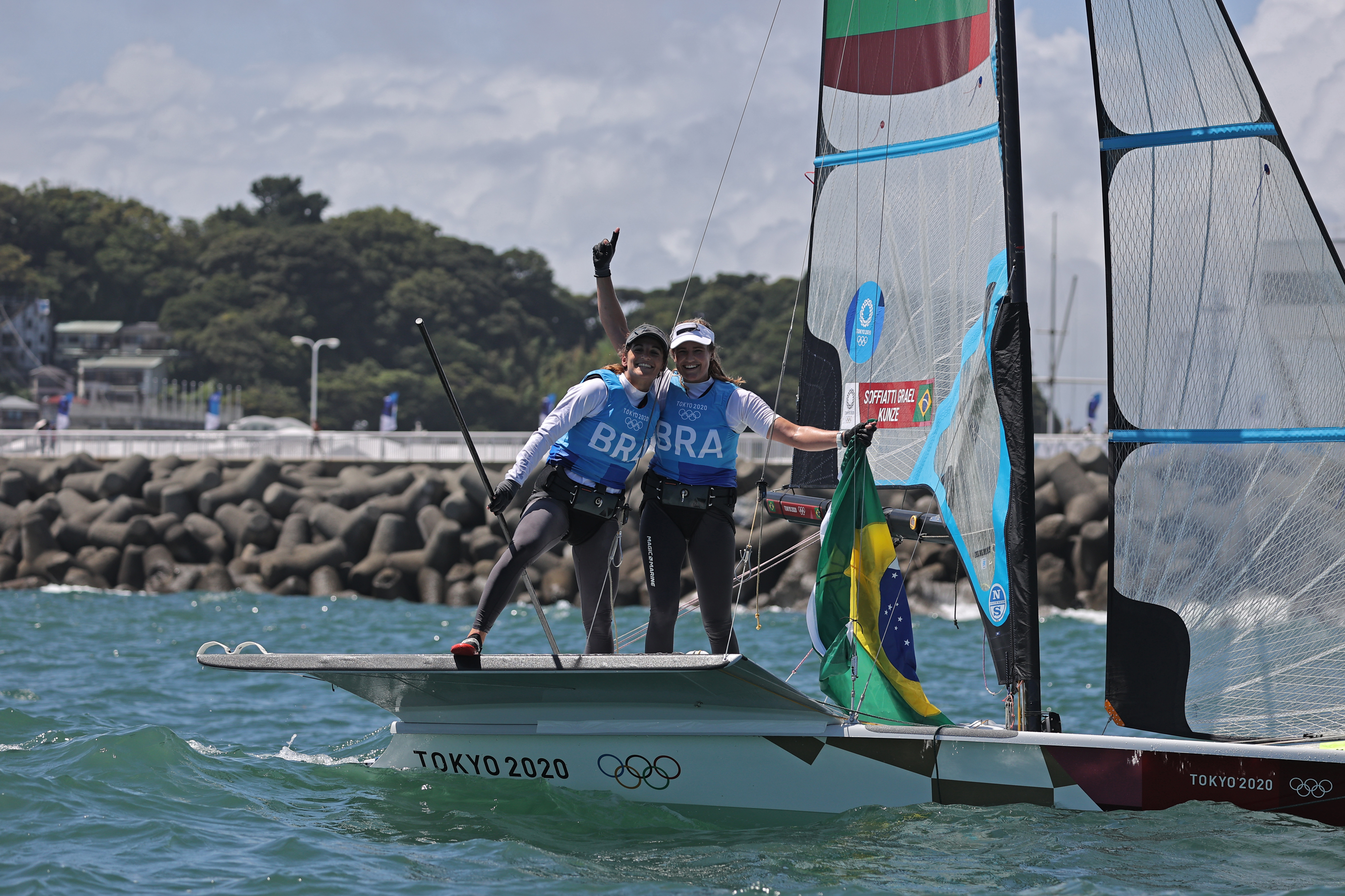 Tokyo 2020 Olympics - Sailing - Women's 49er FX - Medal Race - Enoshima Yacht Harbour - Tokyo, Japan - August 3, 2021. Martine Grael of Brazil and Kahena Kunze of Brazil celebrate winning gold after the race. REUTERS/Carlos Barria