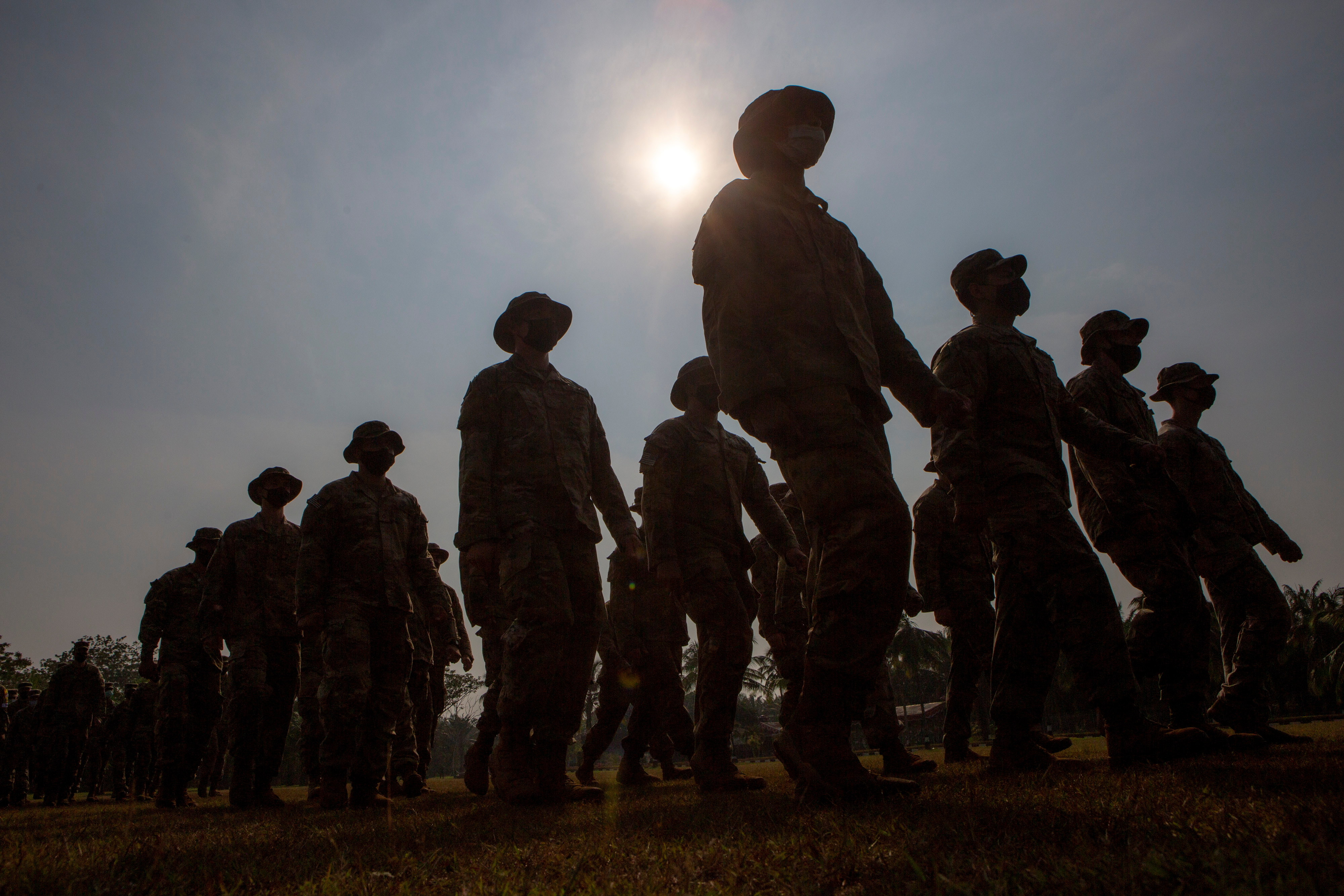 Silhouette of U.S. Army soldiers taking part in the opening of the Garuda Shield Joint Exercise 2021 at the Indonesian Army Combat Training Center in Baturaja, South Sumatra province, Indonesia August 4, 2021. Antara Foto/Nova Wahyudi/via Reuters.