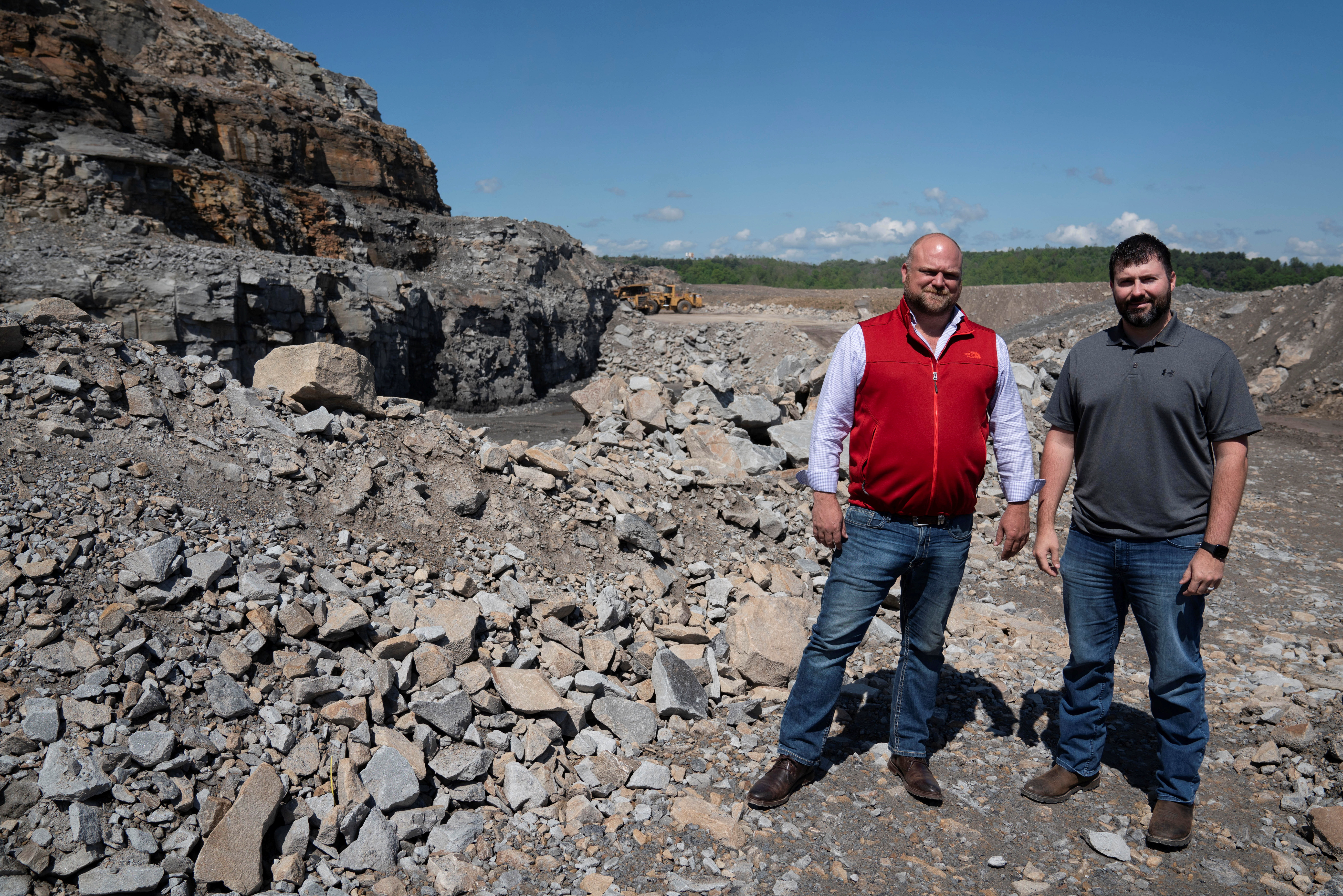 CM Mining Managing Partner Dale Murray (L) and Mining Engineer Chad Damron pose for a photo in an active coal mine located next to a new solar power plant development site in Hurley, western Virginia, U.S., May 11, 2021.  REUTERS/Dane Rhys