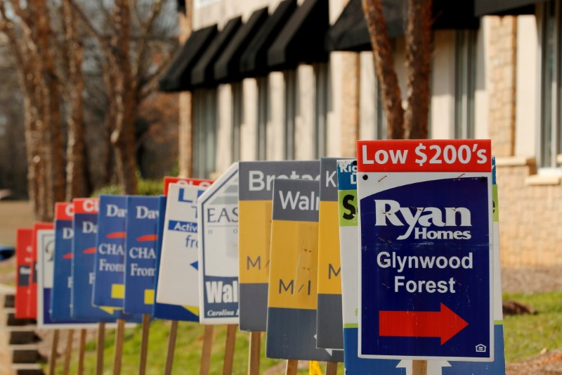 Real estate signs advertise new homes for sale in multiple new developments in York County, South Carolina, U.S., February 29, 2020. REUTERS/Lucas Jackson/File Photo