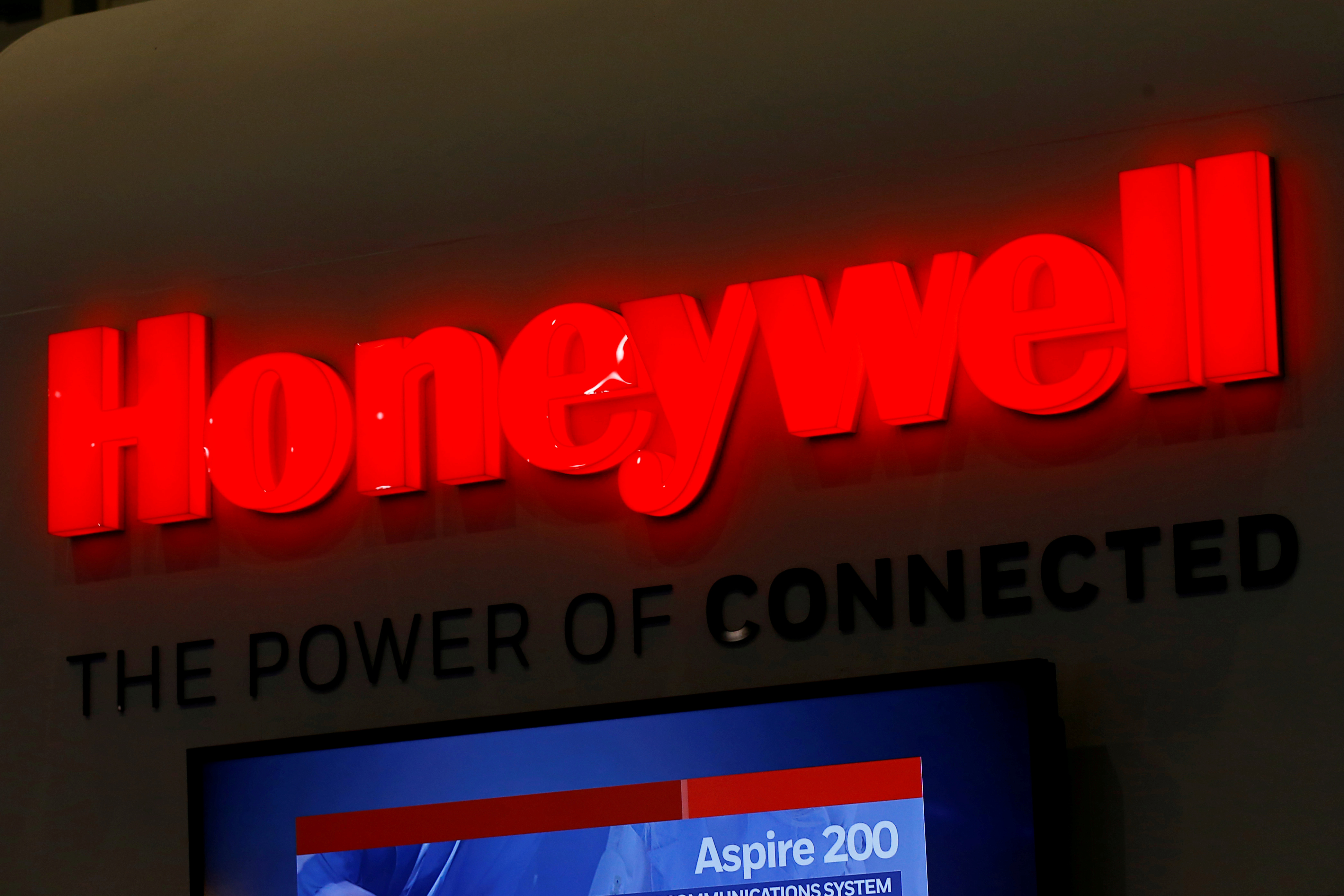 A logo of Honeywell is pictured on their booth during the European Business Aviation Convention & Exhibition (EBACE) in Geneva, Switzerland, May 22, 2017.  REUTERS/Denis Balibouse