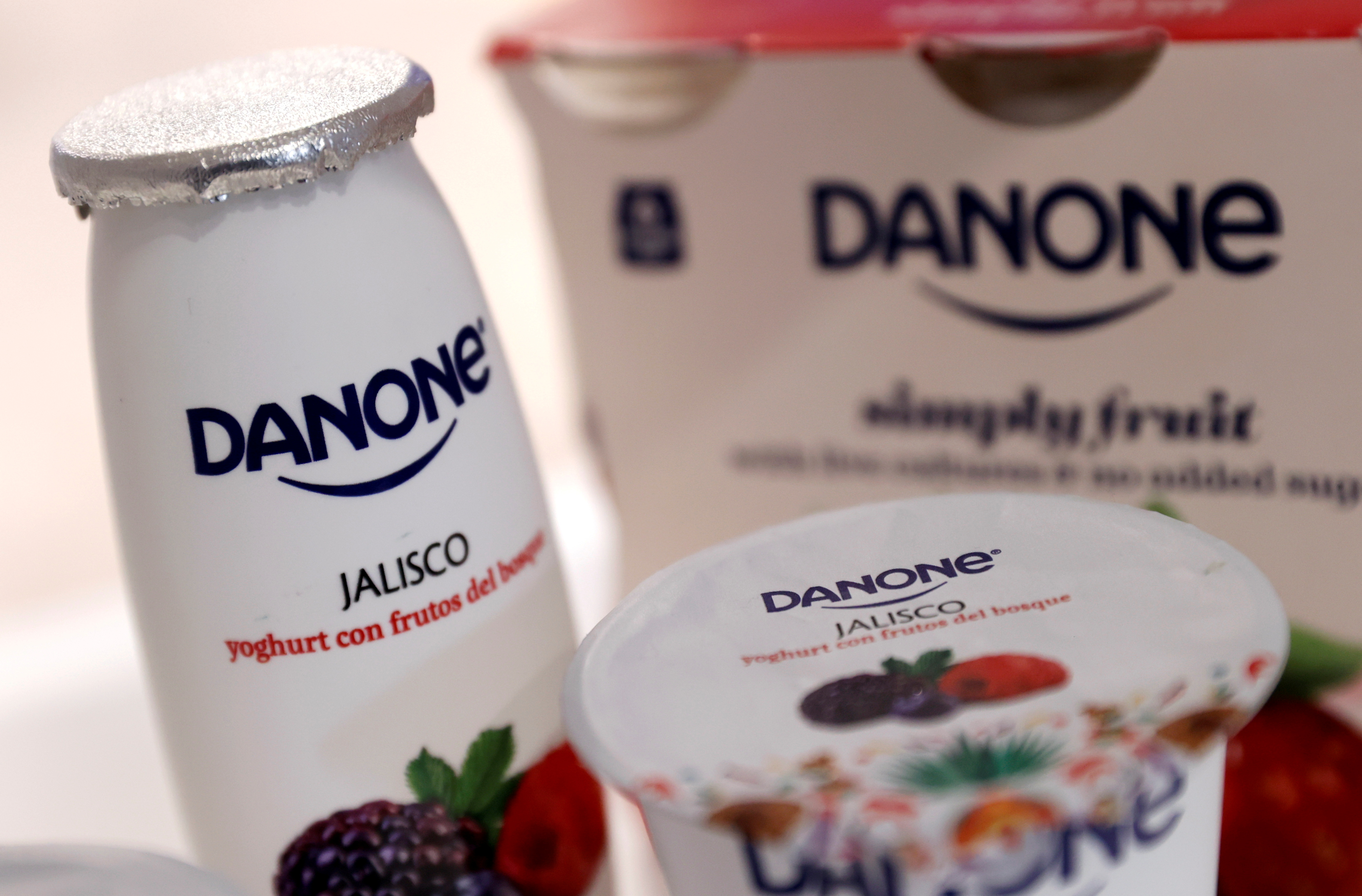 Company logos are seen on products displayed before French food group Danone 2019 annual results presentation in Paris, France, February 26, 2020. REUTERS/Christian Hartmann