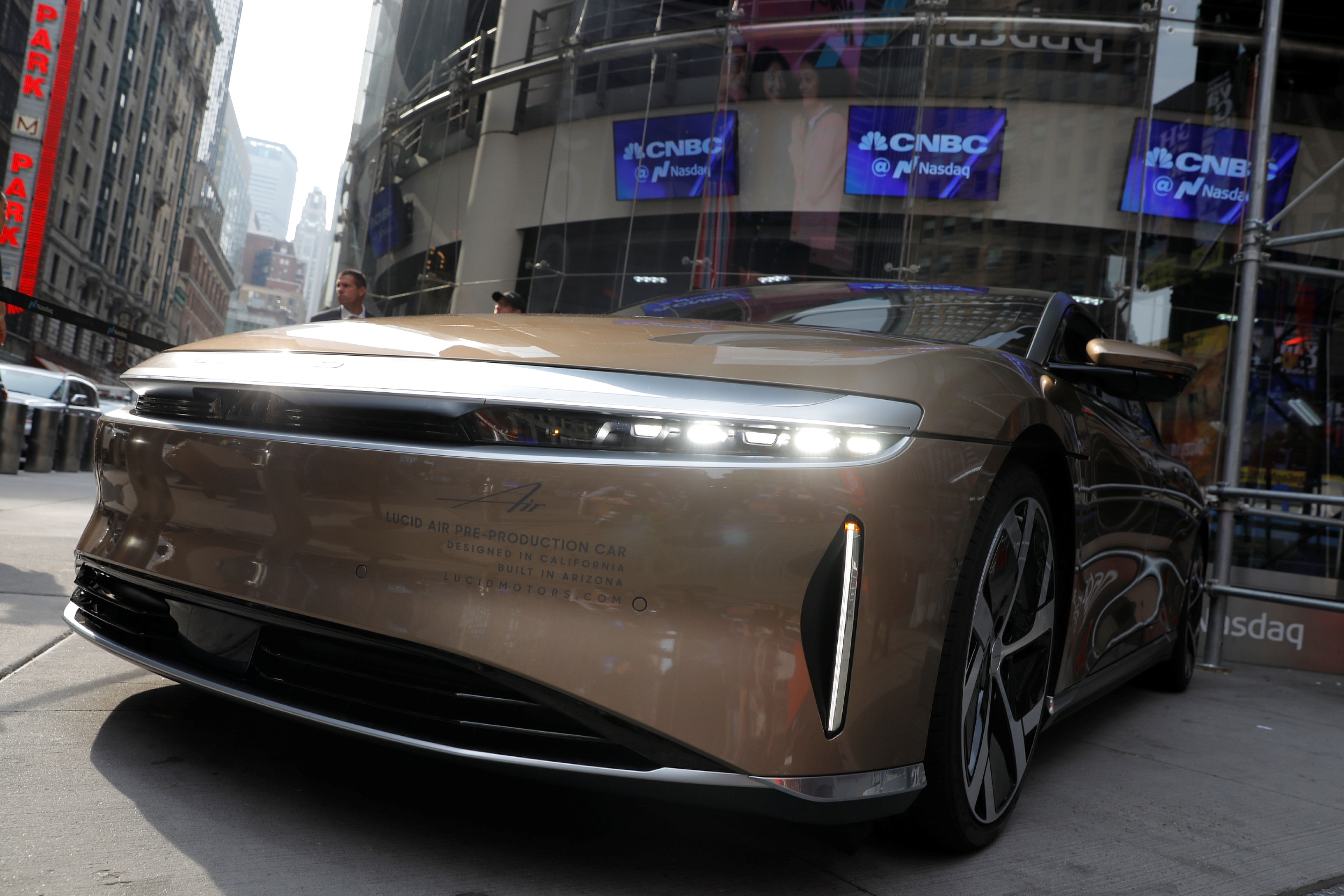 A Lucid Air Dream Edition vehicle is seen outside the Nasdaq MarketSite as Lucid Motors (Nasdaq: LCID) begins trading today on the Nasdaq stock exchange after completing its business combination with Churchill Capital Corp IV in New York City, New York, U.S., July 26, 2021. REUTERS/Andrew Kelly