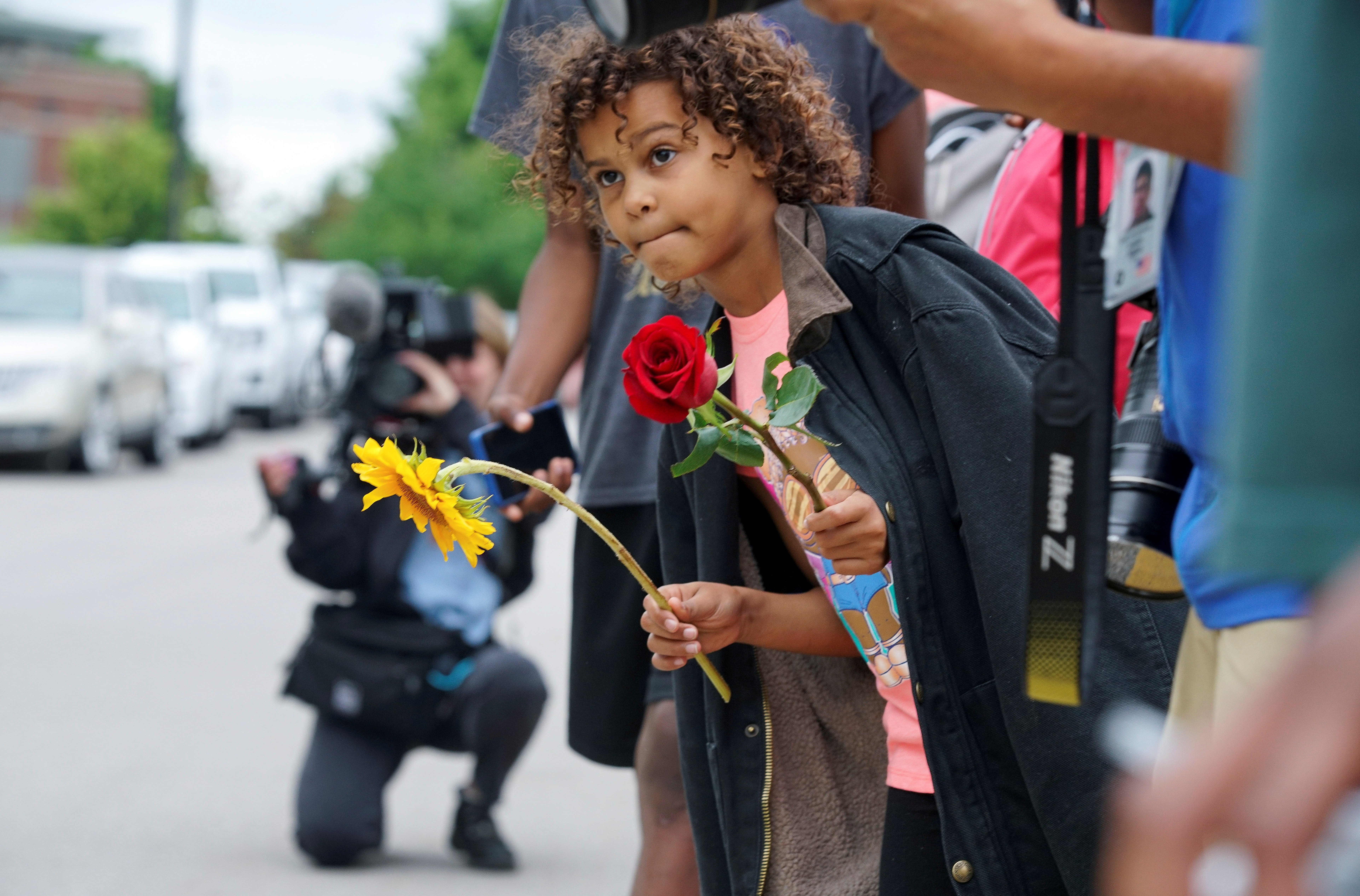 A girl looks out of the crowd hoping to see U.S. President Joe Biden as he visits to mark the 100th anniversary of the 1921 Tulsa Massacre in Tulsa, Oklahoma, U.S., June 1, 2021. REUTERS/Lawrence Bryant/File Photo