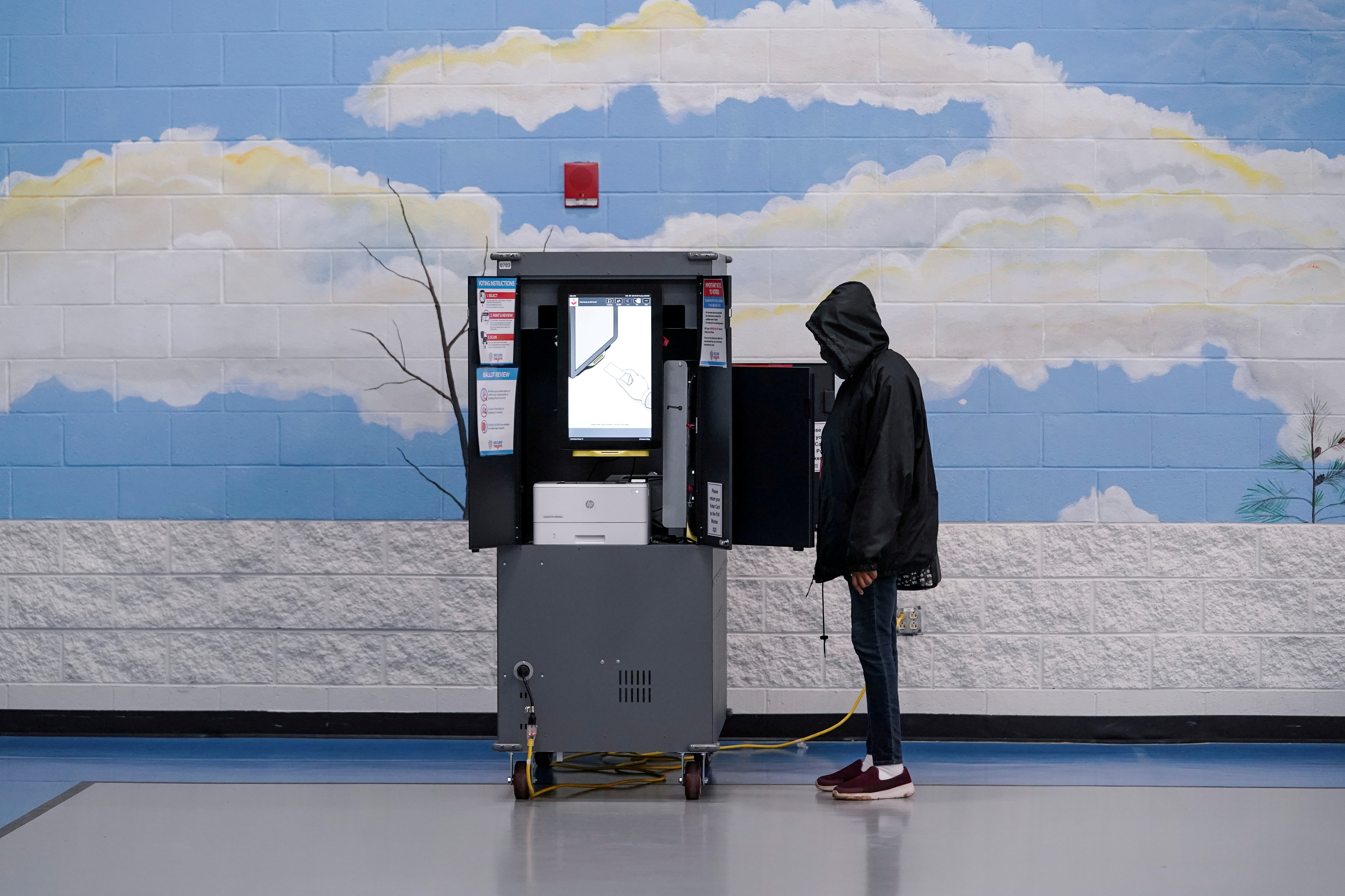 Voters cast their ballots in Georgia's Senate runoff elections at a Fulton County polling station in Atlanta, Georgia, U.S. January 5, 2021.  REUTERS/Elijah Nouvelage/File Photo