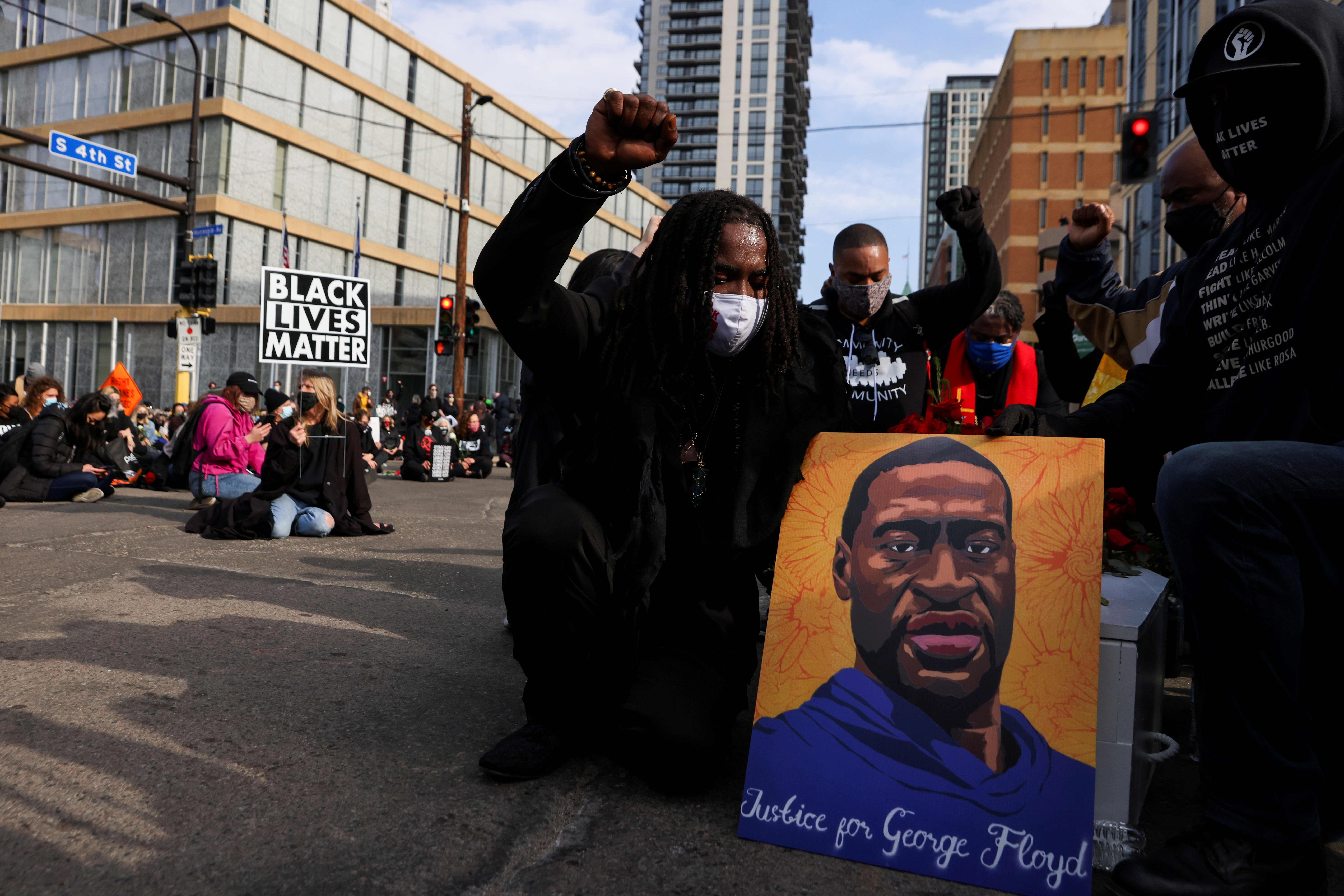 People take part in a rally the day before jury selection is scheduled to begin for the trial of former Minneapolis policeman Derek Chauvin, who is accused of killing George Floyd, in Minneapolis, Minnesota, U.S. March 7, 2021. REUTERS/Leah Millis REFILE - CORRECTING INFORMATION - RC2L6M9LA4PF