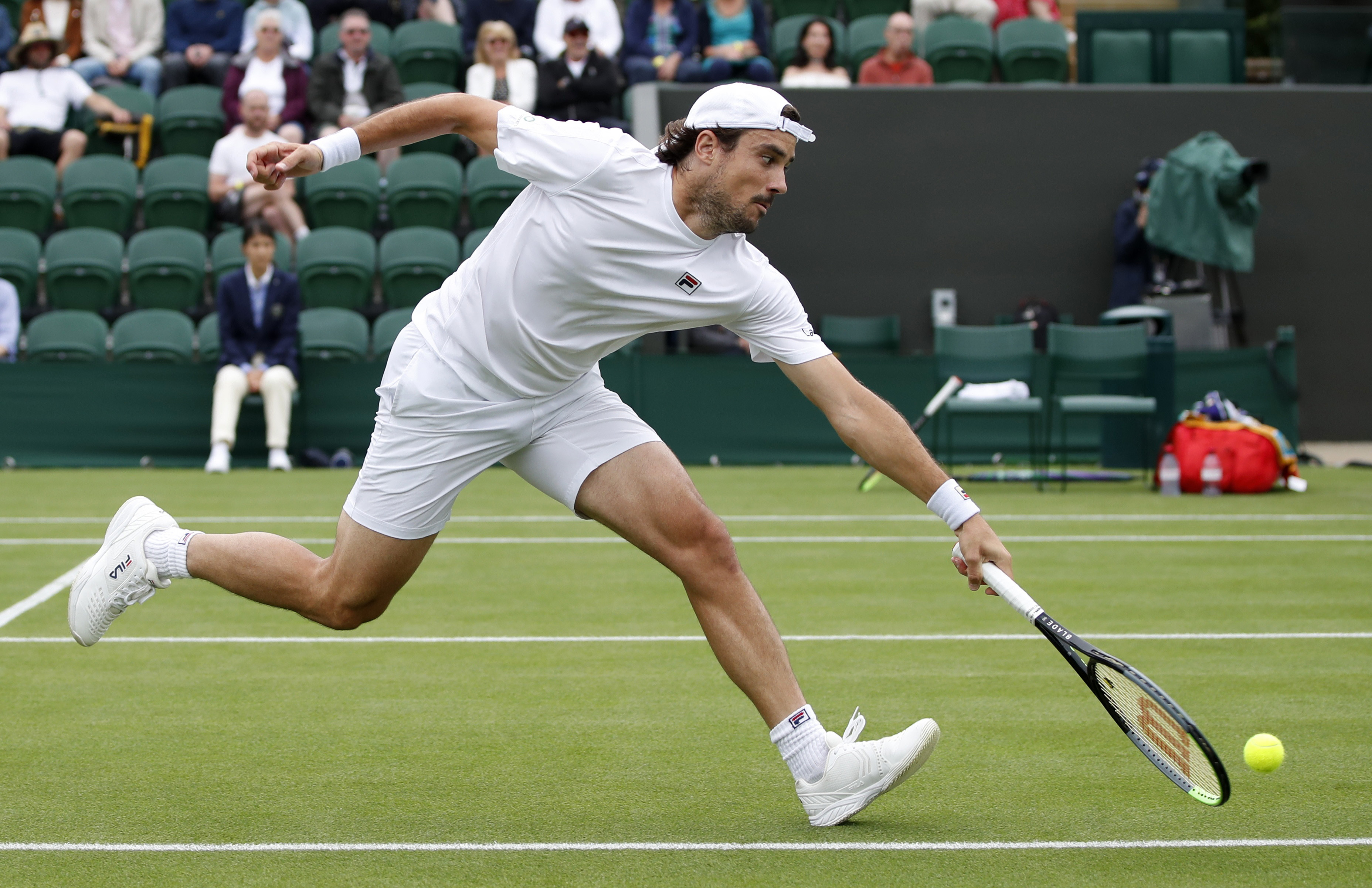 Tennis - Wimbledon - All England Lawn Tennis and Croquet Club, London, Britain - June 30, 2021 Argentina's Guido Pella in action during his first round match against Italy's Matteo Berrettini REUTERS/Paul Childs