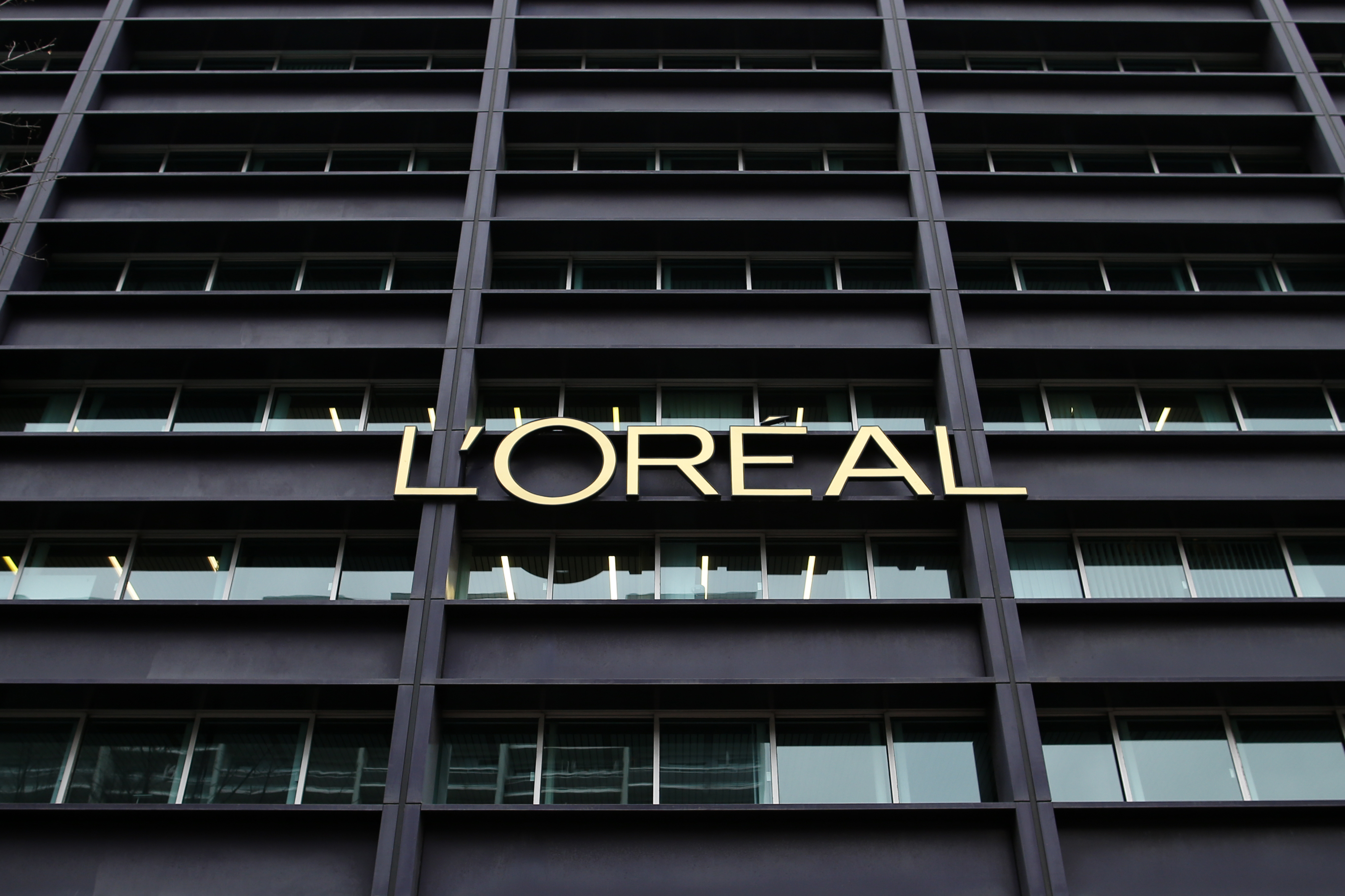 The logo of French cosmetics group L'Oreal is seen on the company's building in Clichy, near Paris February 11, 2014.  REUTERS/Benoit Tessier /File Photo