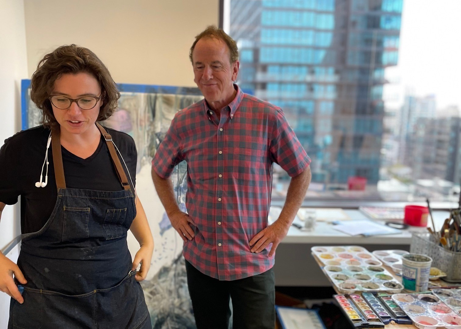 Artist Molly Segal (L) and firm founder John Quinn (R). Photo courtesy of Alexis Hyde