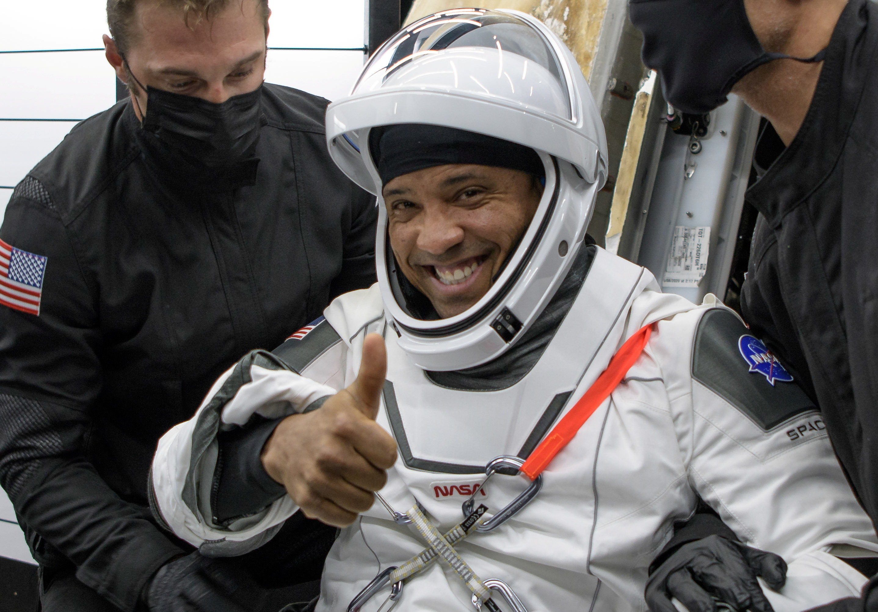 NASA astronaut Victor Glover is helped out of the SpaceX Crew Dragon Resilience spacecraft onboard the SpaceX GO Navigator recovery ship after he, NASA astronauts Mike Hopkins, Shannon Walker, and Japan Aerospace Exploration Agency (JAXA) astronaut Soichi Noguchi, landed in the Gulf of Mexico off the coast of Panama City, Florida, U.S. May 2, 2021. NASA/Bill Ingalls/Handout via REUTERS