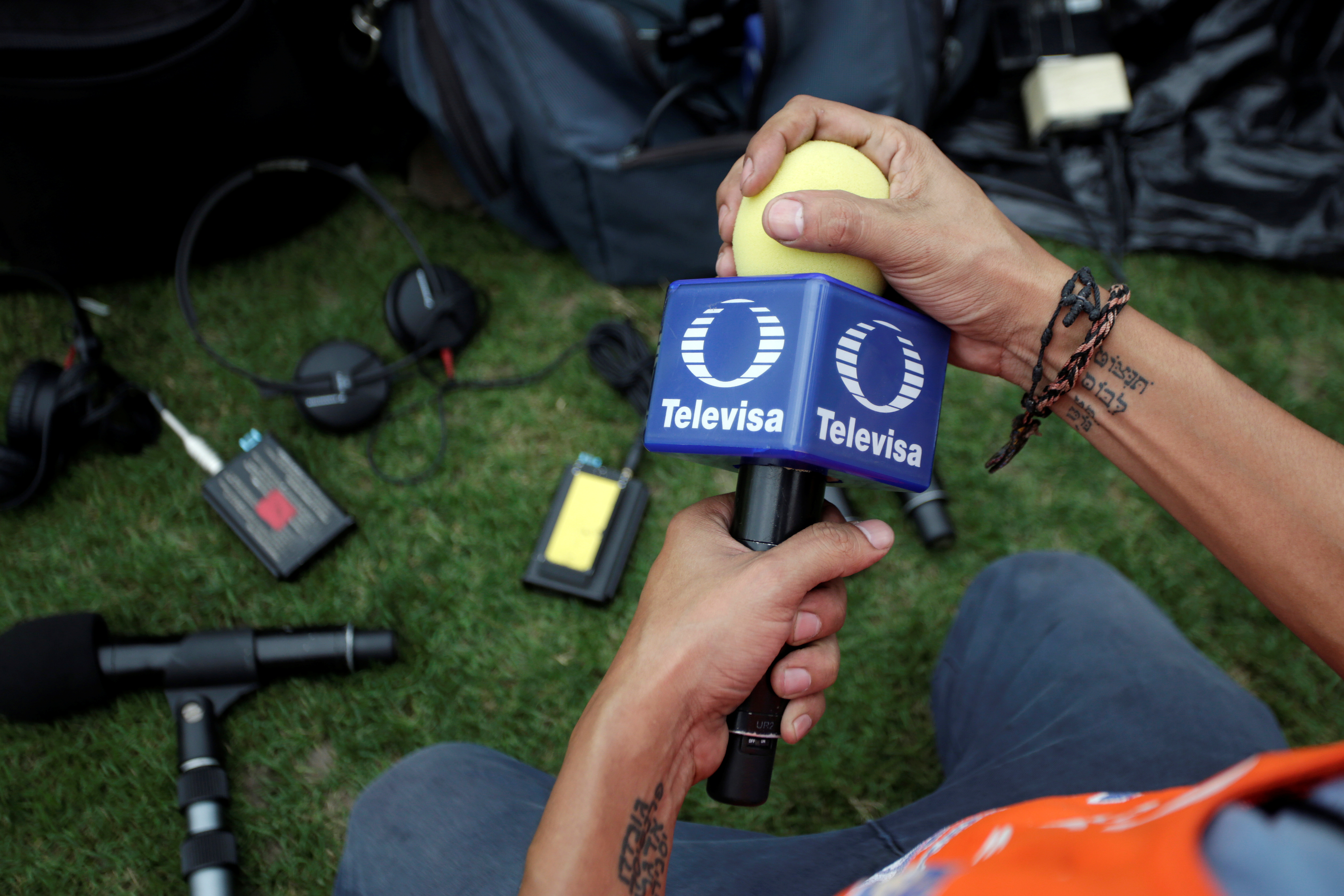 A technician holds a microphone of Mexican broadcaster Televisa before a soccer match at Universitario stadium in San Nicolas de los Garza, on the outskirts of Monterrey, Mexico May 3, 2018. Picture taken May 3, 2018. REUTERS/Daniel Becerril