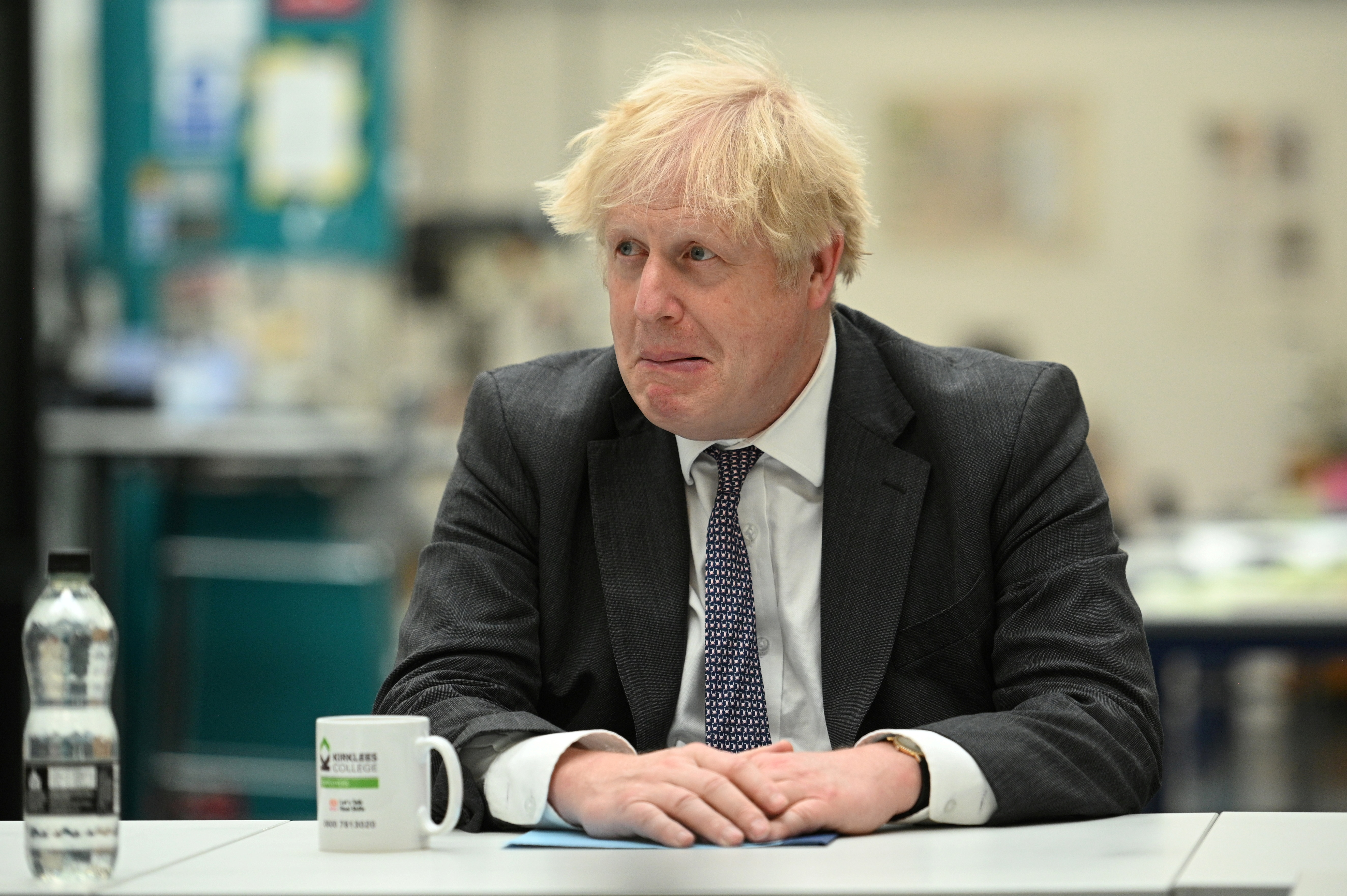 Britain's Prime Minister Boris Johnson chats with teachers in the Arts and Design area during a visit to Kirklees College Springfield Sixth Form Centre in Dewsbury, West Yorkshire, Britain June 18, 2021. Oli Scarff/Pool via REUTERS