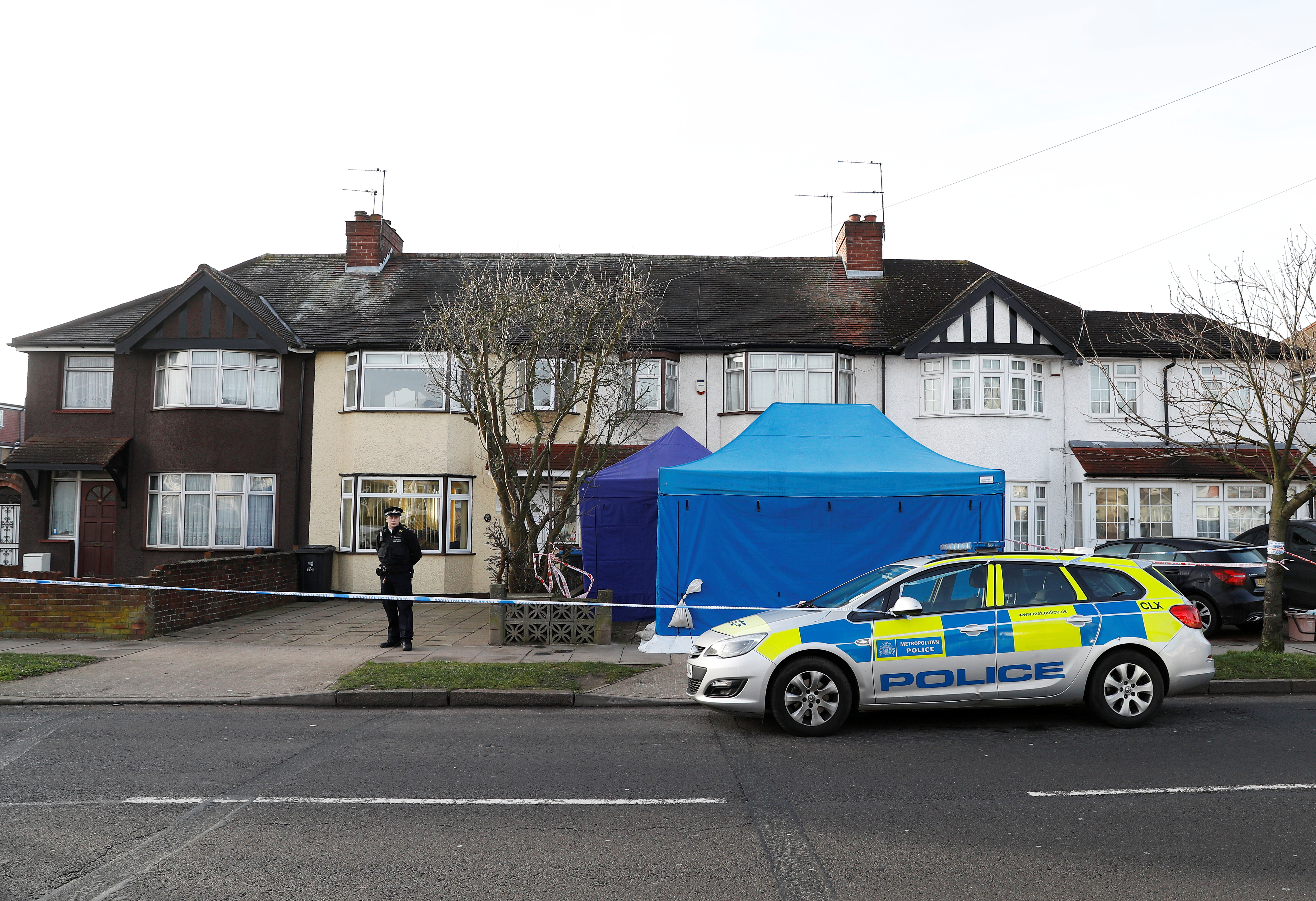 Police stand on duty outside the home of Nikolai Glushkov in New Malden, on the outskirts of London Britain, March 14, 2018. REUTERS/Peter Nicholls