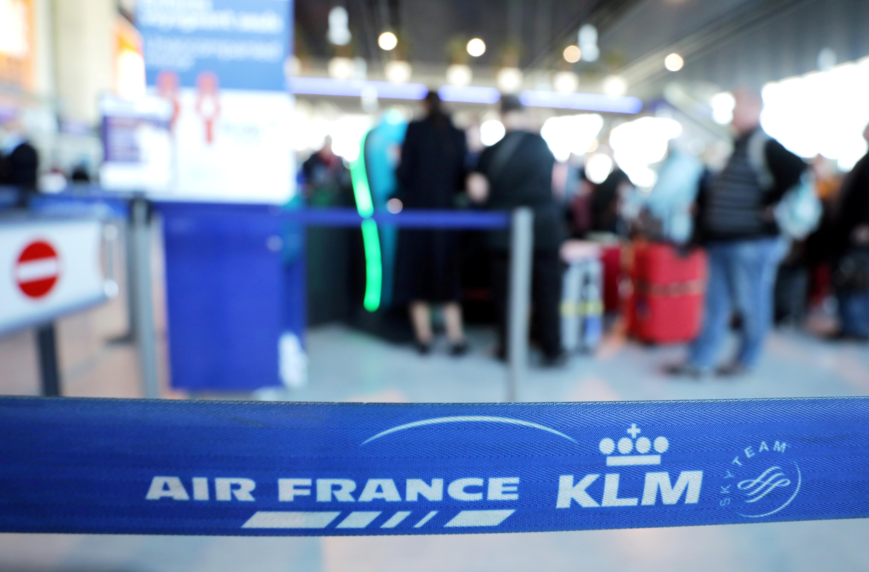 Passengers wait at the Air France desk at Nice international airport, France, February 20, 2020. REUTERS/Eric Gaillard