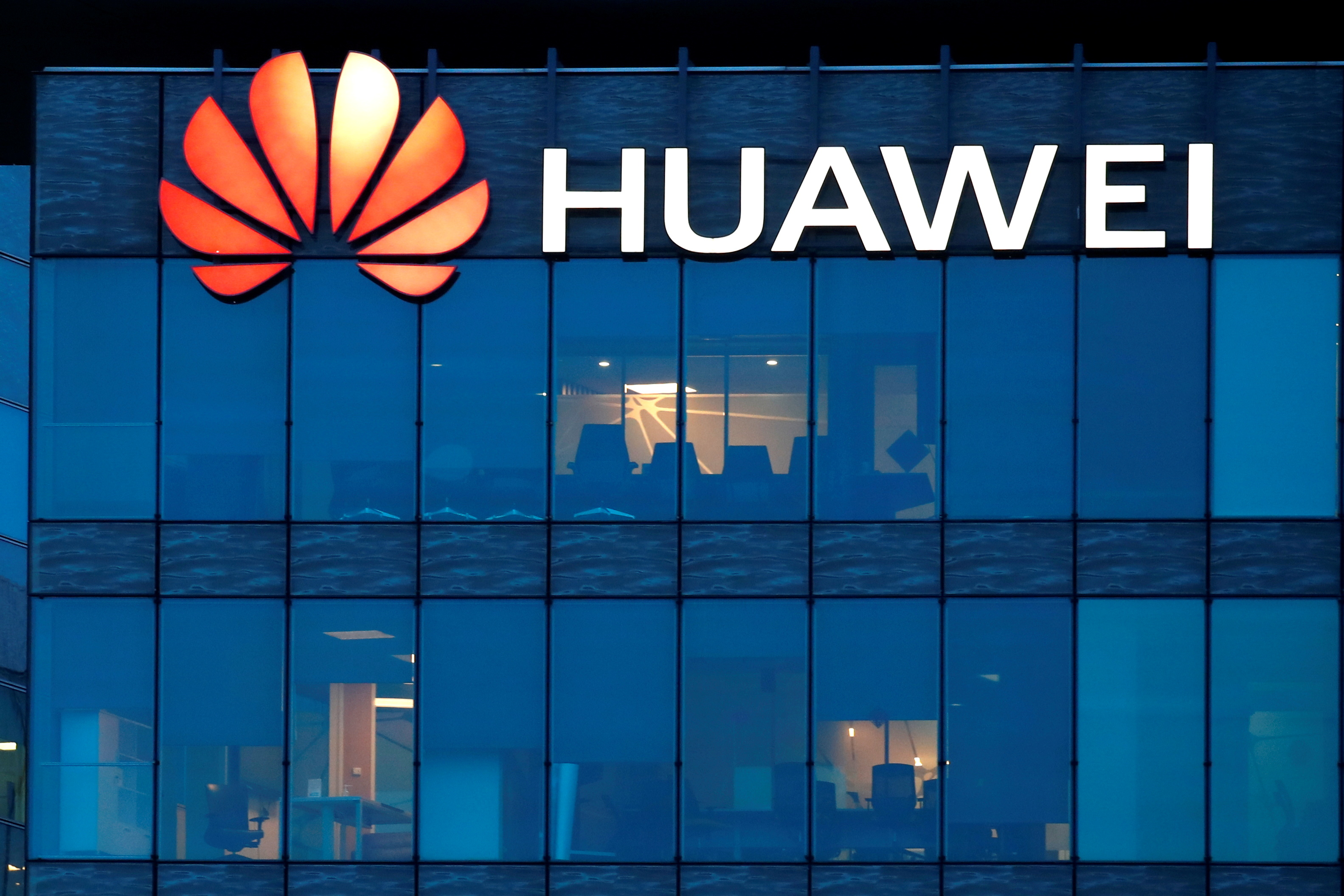 A view shows a Huawei logo at Huawei Technologies France headquarters in Boulogne-Billancourt near Paris, France, February 17, 2021. REUTERS/Gonzalo Fuentes/File Photo