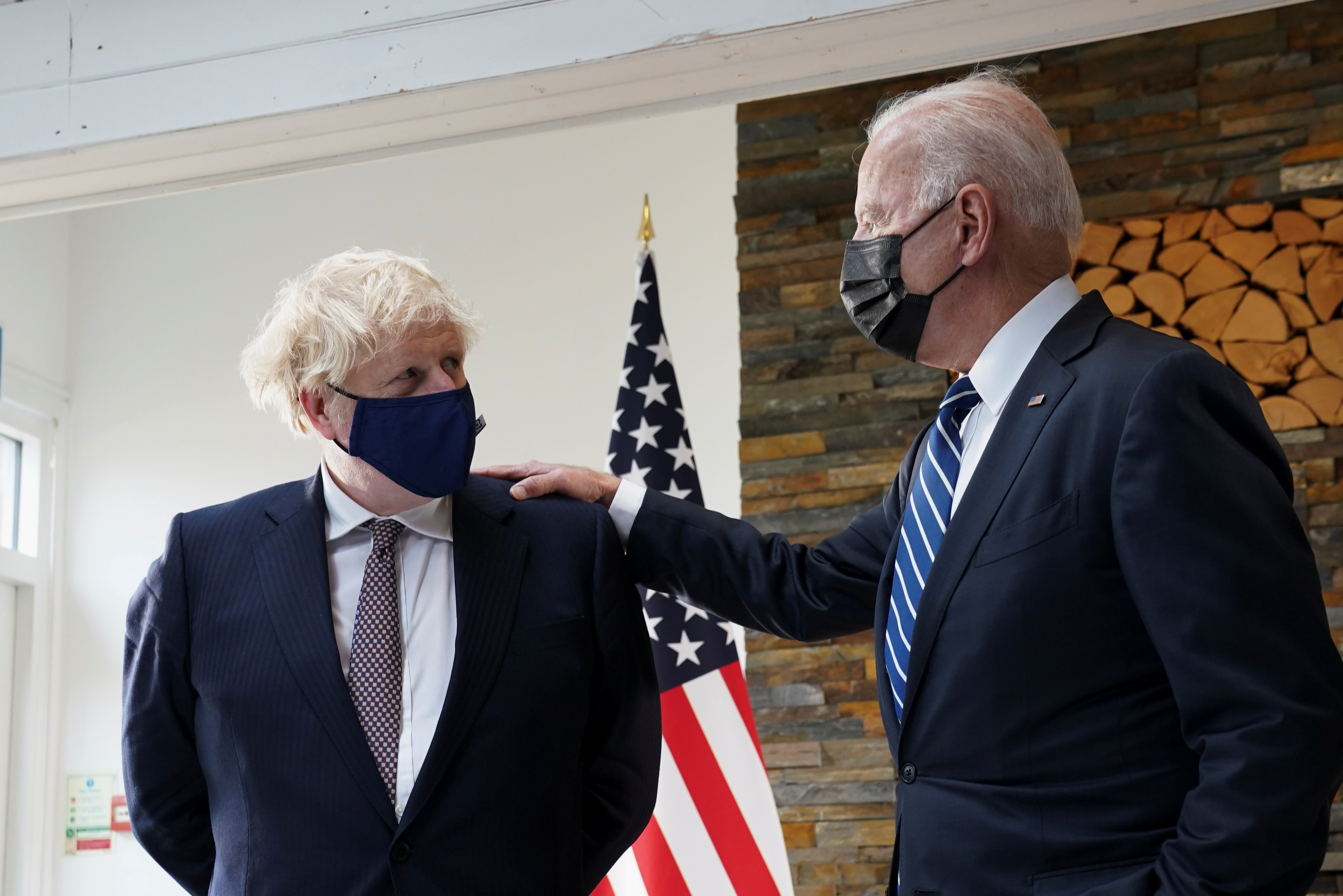 U.S. President Joe Biden speaks with Britain's Prime Minister Boris Johnson, as they look at historical documents and artefacts relating to the Atlantic Charter during their meeting, at Carbis Bay Hotel, Carbis Bay, Cornwall, Britain June 10, 2021 REUTERS/Kevin Lamarque