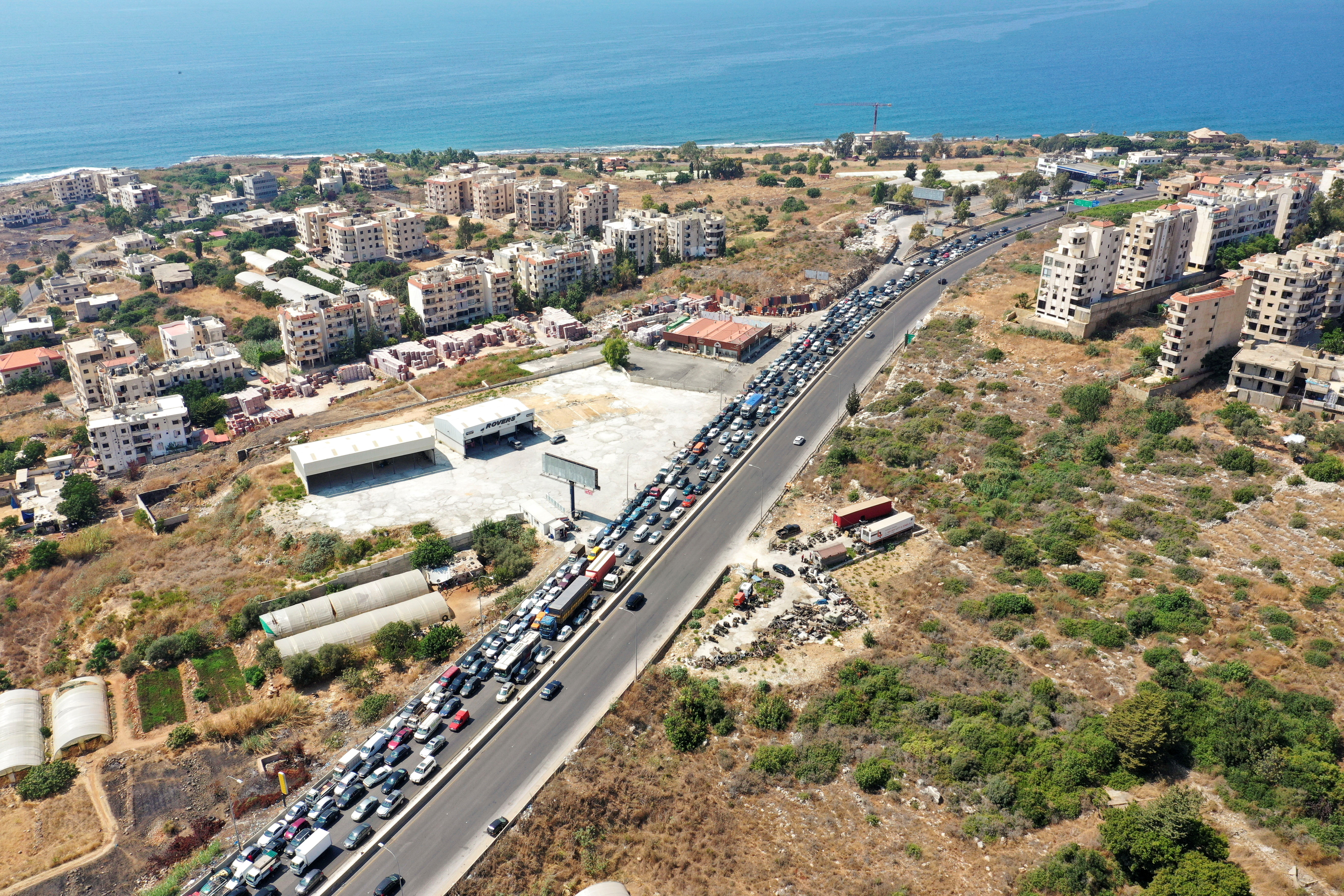 Traffic jam caused by cars lining up for fuel in Damour, Lebanon August 21, 2021. Picture taken August 21, 2021. Picture taken with a drone. REUTERS/Issam Abdallah