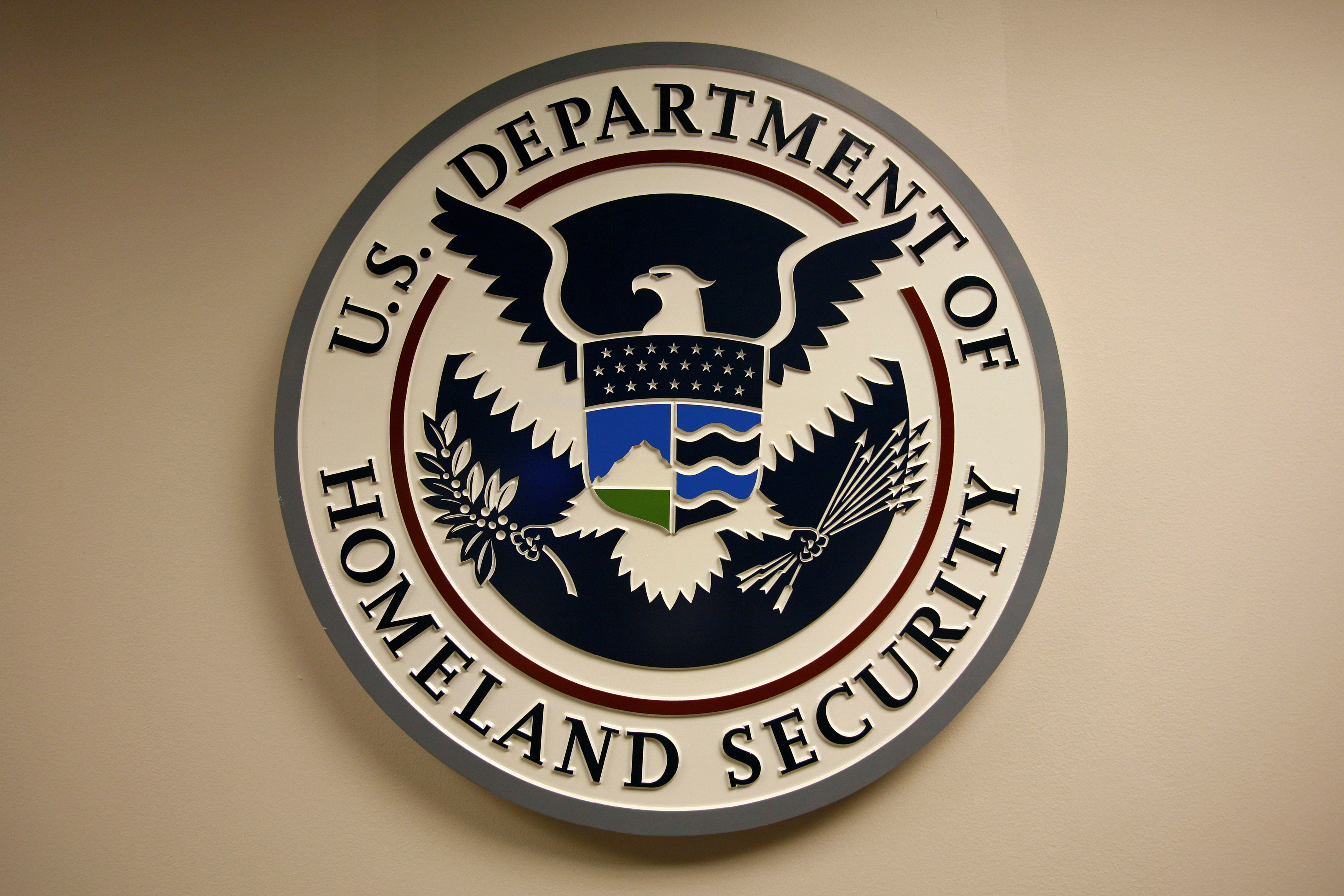 U.S. Department of Homeland Security emblem is pictured at the National Cybersecurity & Communications Integration Center (NCCIC) located just outside Washington in Arlington, Virginia September 24, 2010.  REUTERS/Hyungwon Kang/File Photo