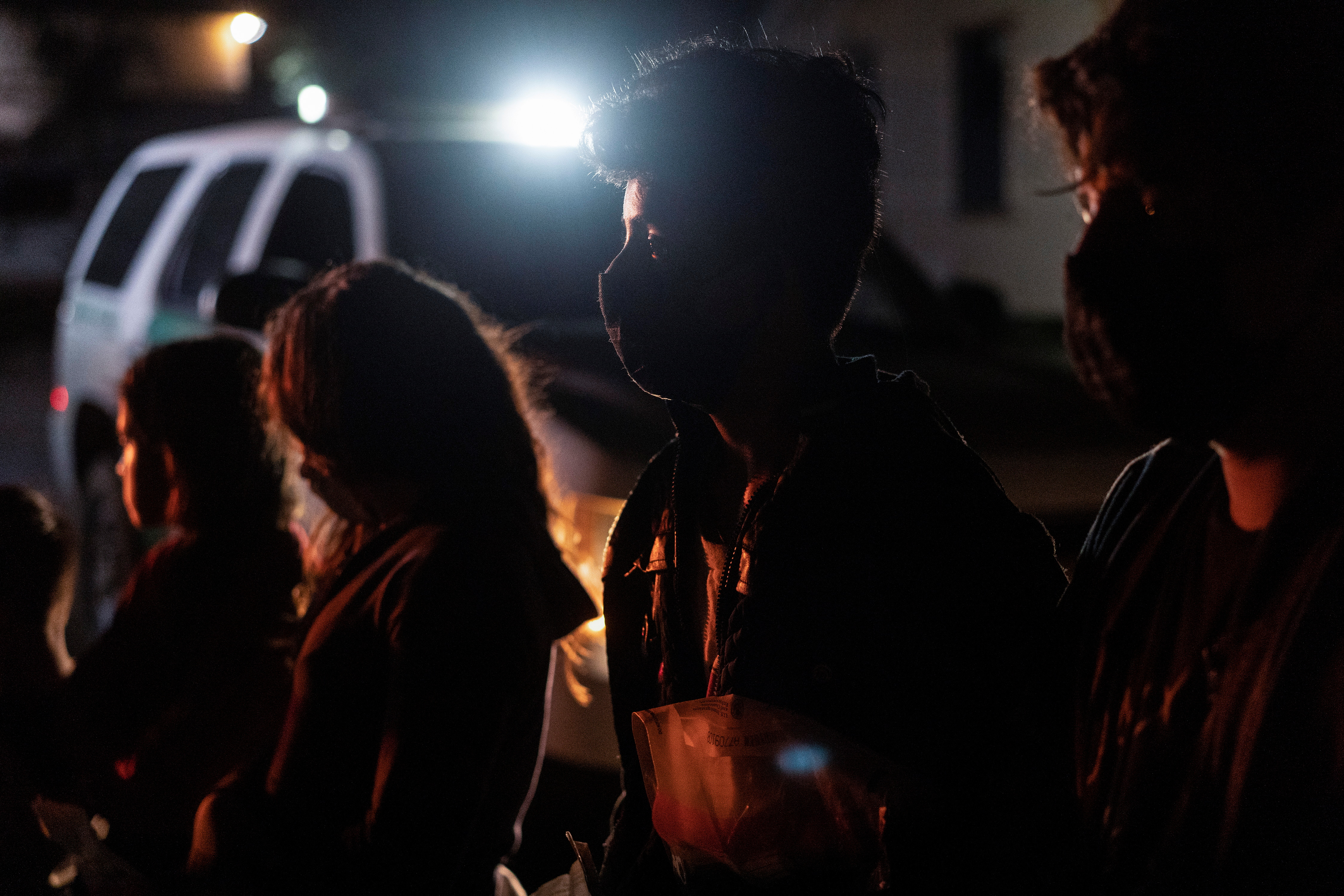 Unaccompanied minor migrants from Central America wait to be processed by the U.S. Border Patrol agents after crossing the Rio Grande river into the United States from Mexico in Roma, Texas, U.S., July 30, 2021. REUTERS/Go Nakamura