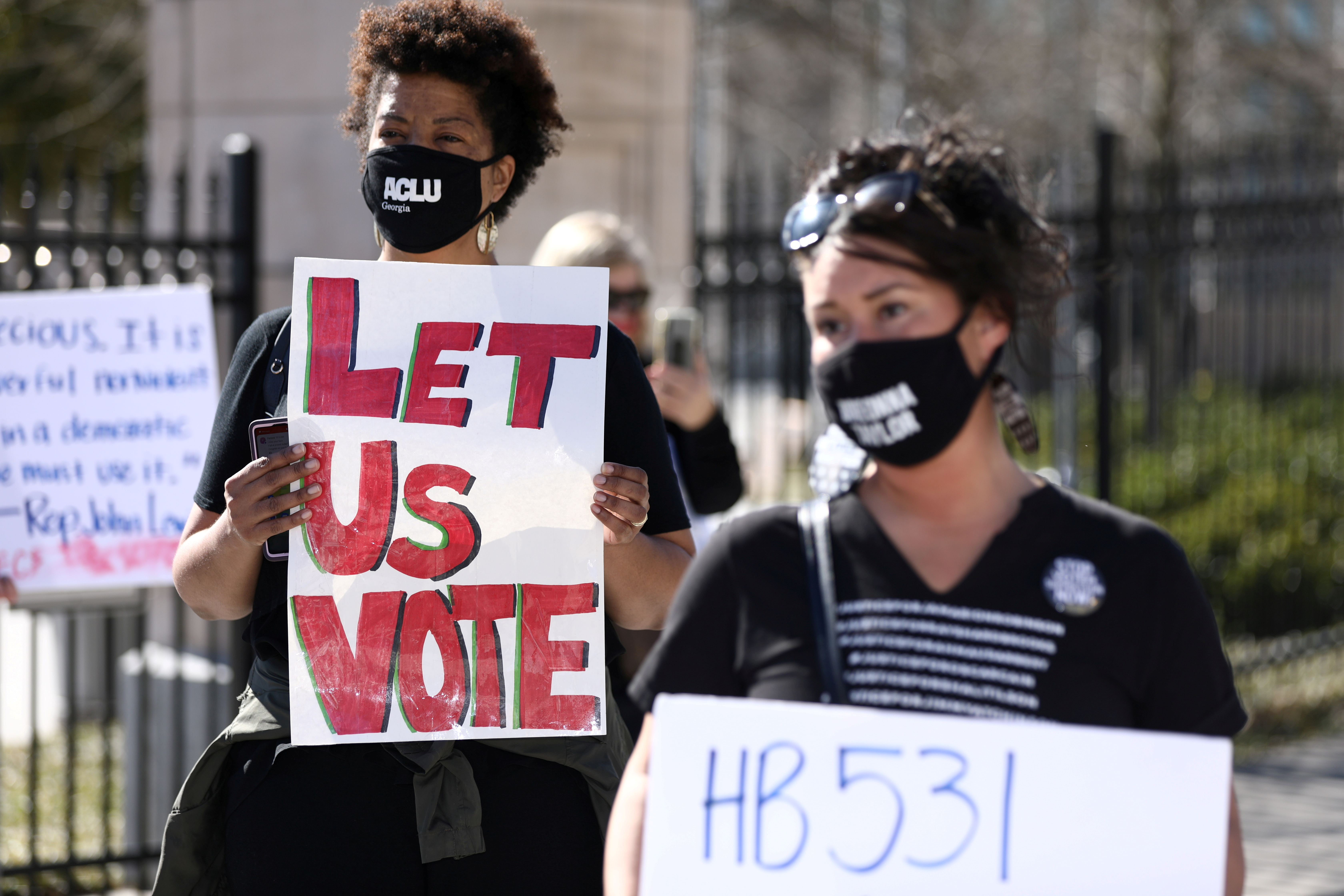 Protesters gather outside of the Georgia State Capitol to protest HB 531, which would place tougher restrictions on voting in Georgia, in Atlanta, Georgia, U.S. March 4, 2021. REUTERS/Dustin Chambers/File Photo