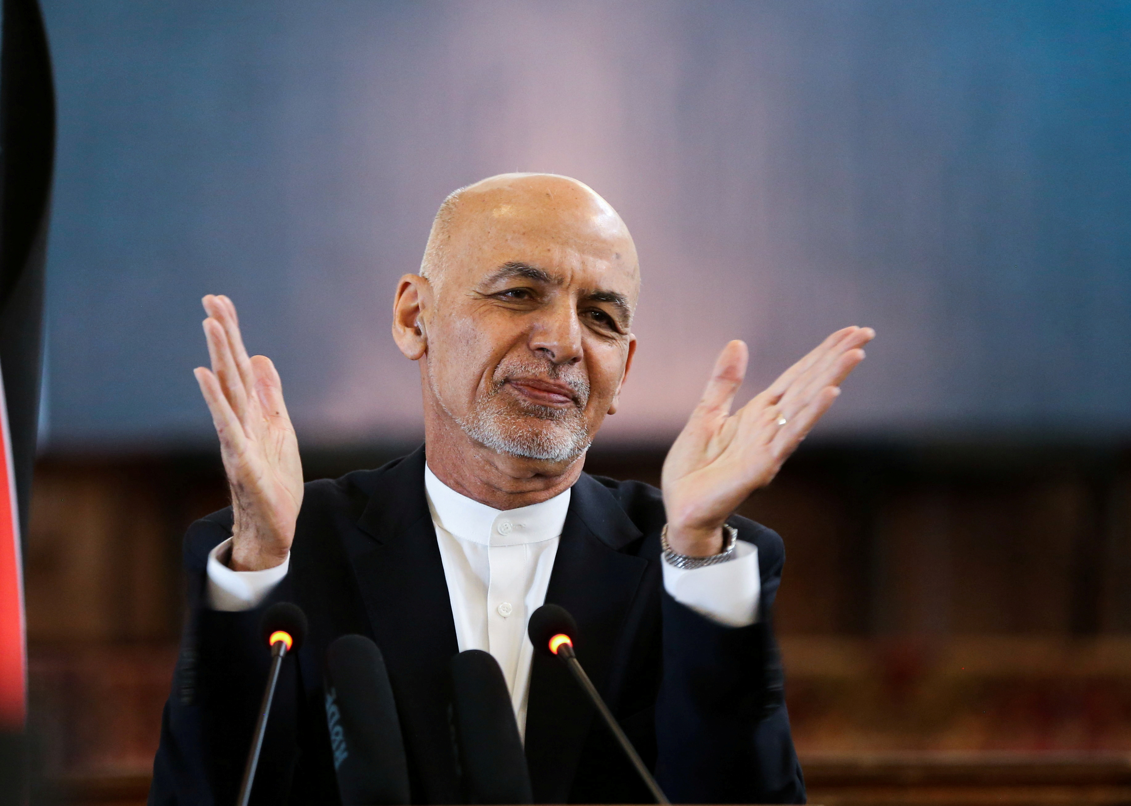 Afghanistan's President Ashraf Ghani gestures during celebrations to mark Afghan New Year (Newroz), in Kabul, Afghanistan March 21, 2021. REUTERS/Omar Sobhani/File Photo